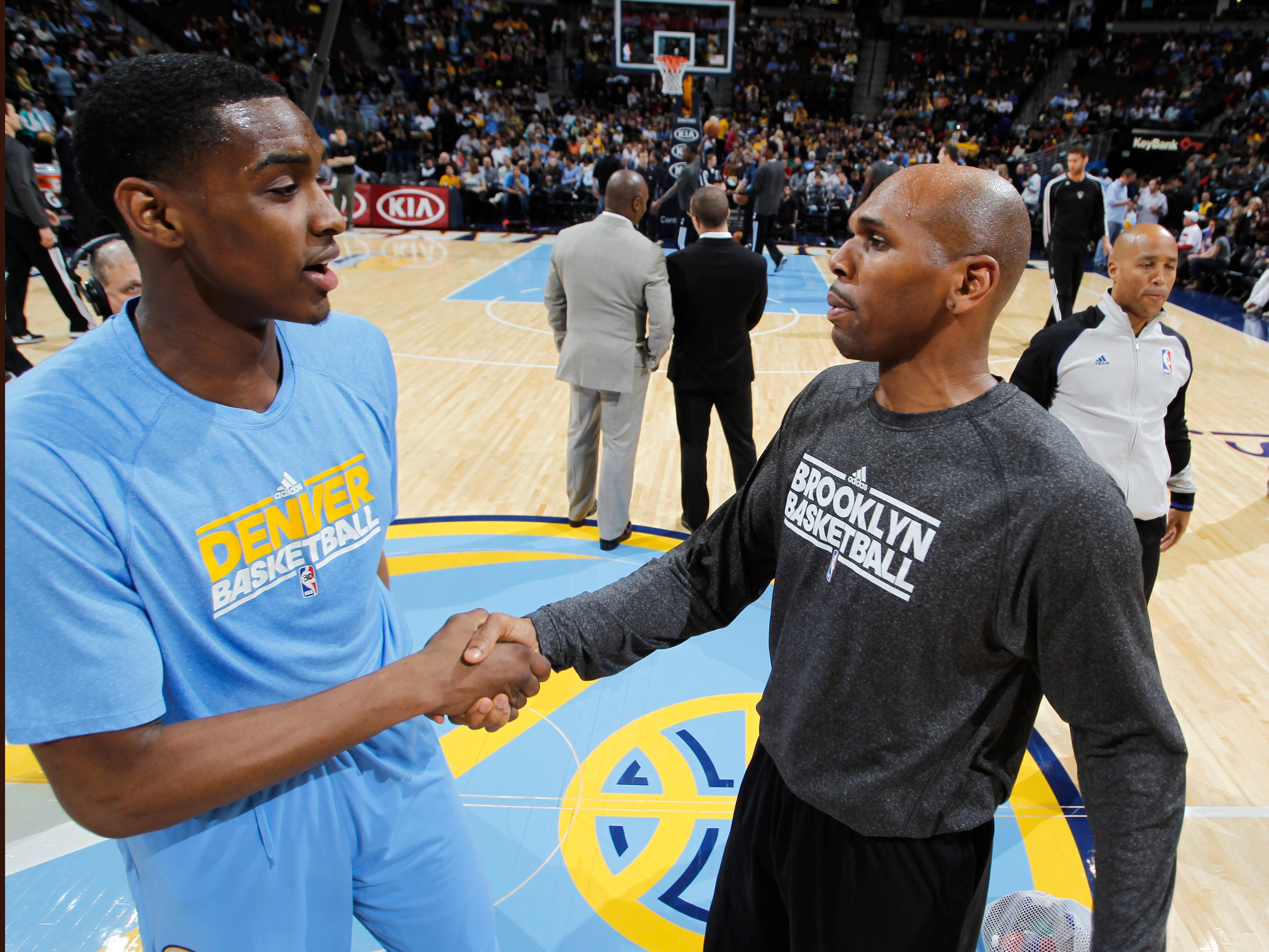 Brooklyn Nets forward Jerry Stackhouse, right, greets Denver Nuggets rookie forward Quincy Miller before the first quarter of an NBA basketball game in Denver, Friday, March 29, 2013.