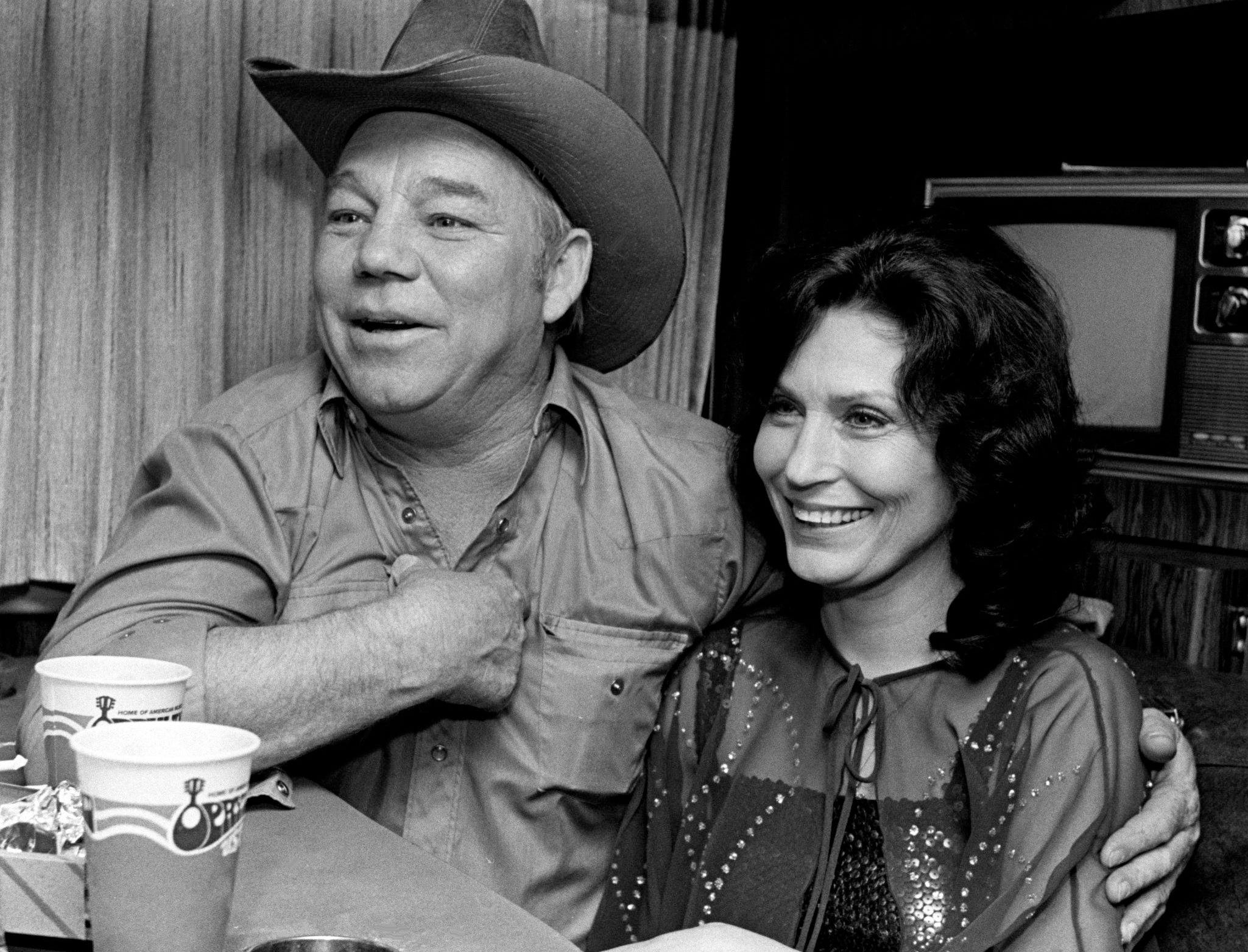 """Mooney Lynn, left, is with his wife, Loretta Lynn, in the cabin of Loretta's touring bus parked at Opry House March 1, 1980. They are waiting for the upcoming premiere in a couple days of """"Coal Miner's Daughter,"""" the movie version of Lynn's autobiography."""