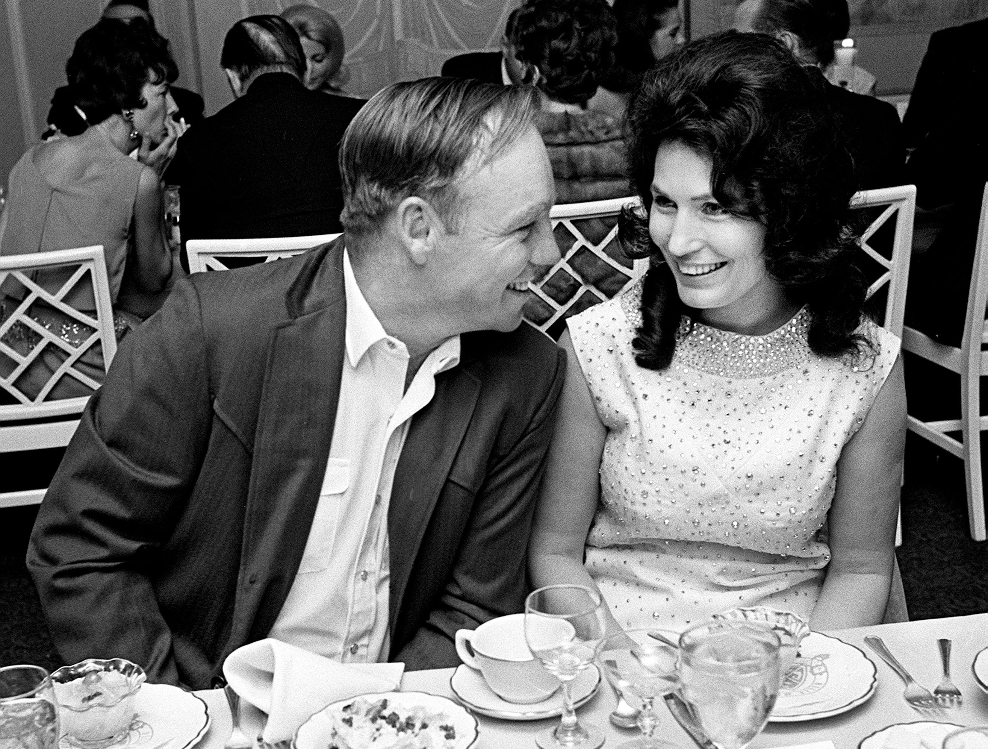 """Loretta Lynn, right, and her husband, Oliver """"Mooney"""" Lynn, enjoy themselves during the BMI awards banquet at the Belle Meade Country Club on Oct. 20, 1966."""