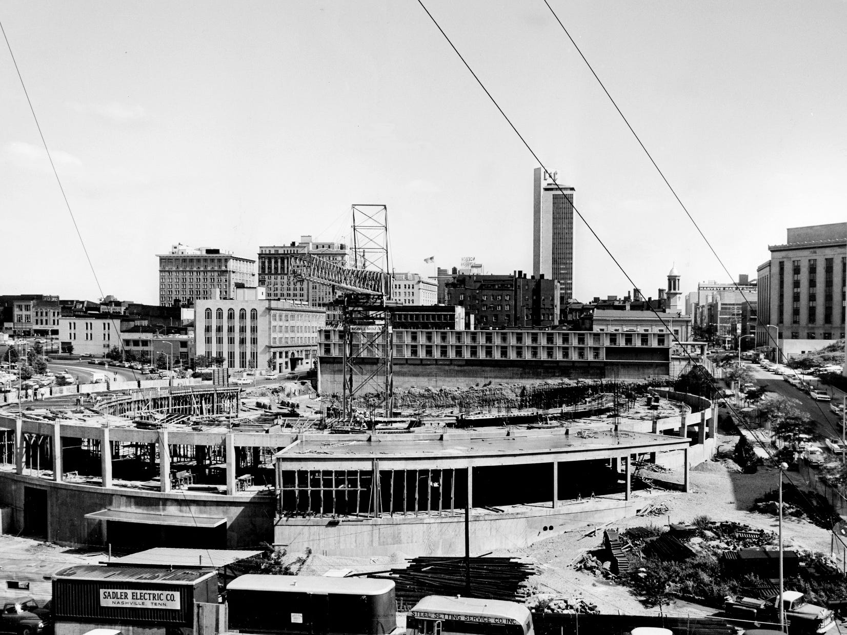 Nashville's $5 million Municipal Auditorium begins to take shape May 15, 1961, as construction workers strive to make up days lost during winter weather. The auditorium, which will seat 10,800, is scheduled for completion in July 1962.