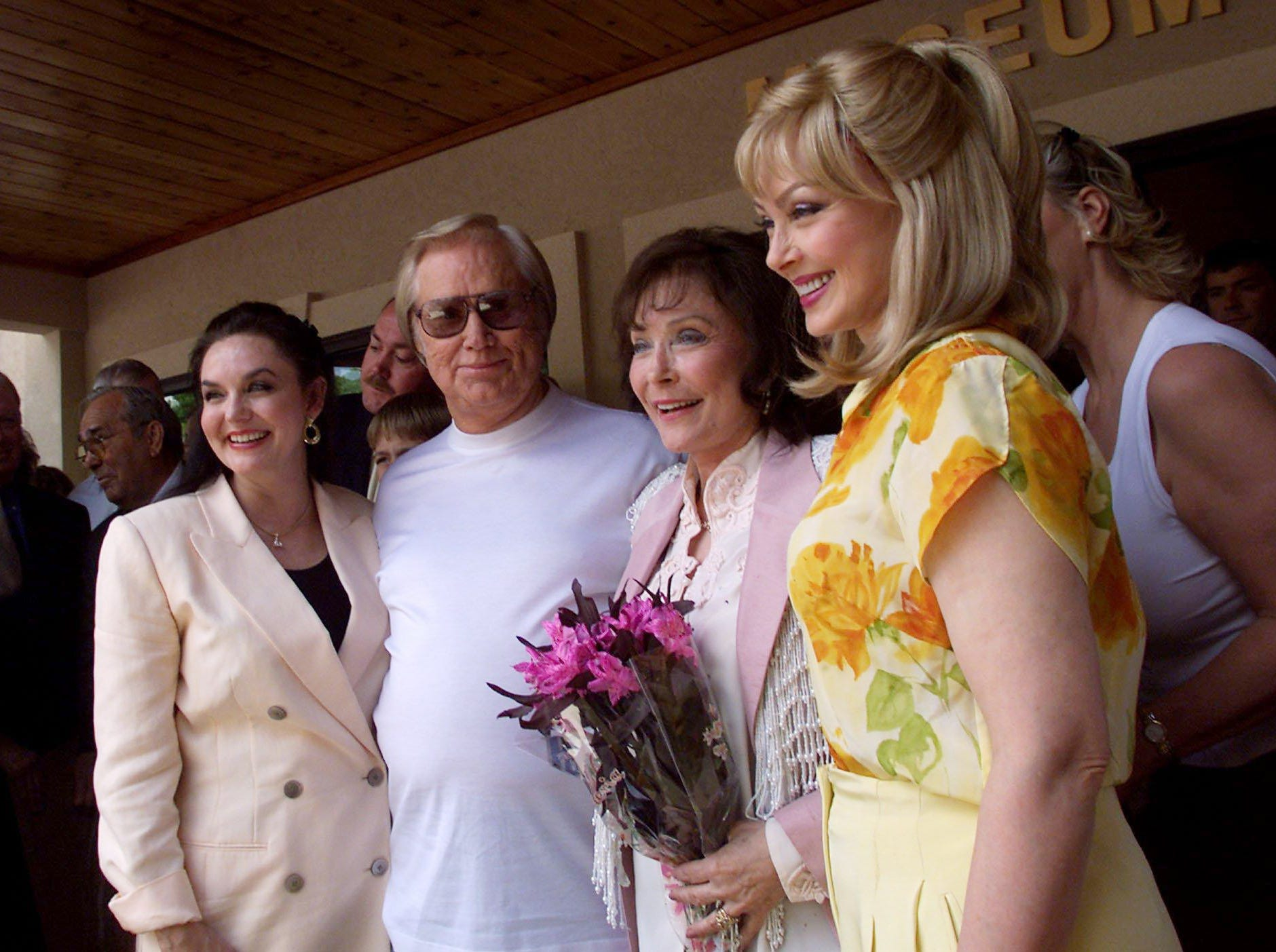 Crystal Gayle, left, George Jones, Loretta Lynn and Naomi Judd get together during the opening ceremonies for the grand opening of the Loretta Lynn Hurricane Mills Museum May 26, 2001.
