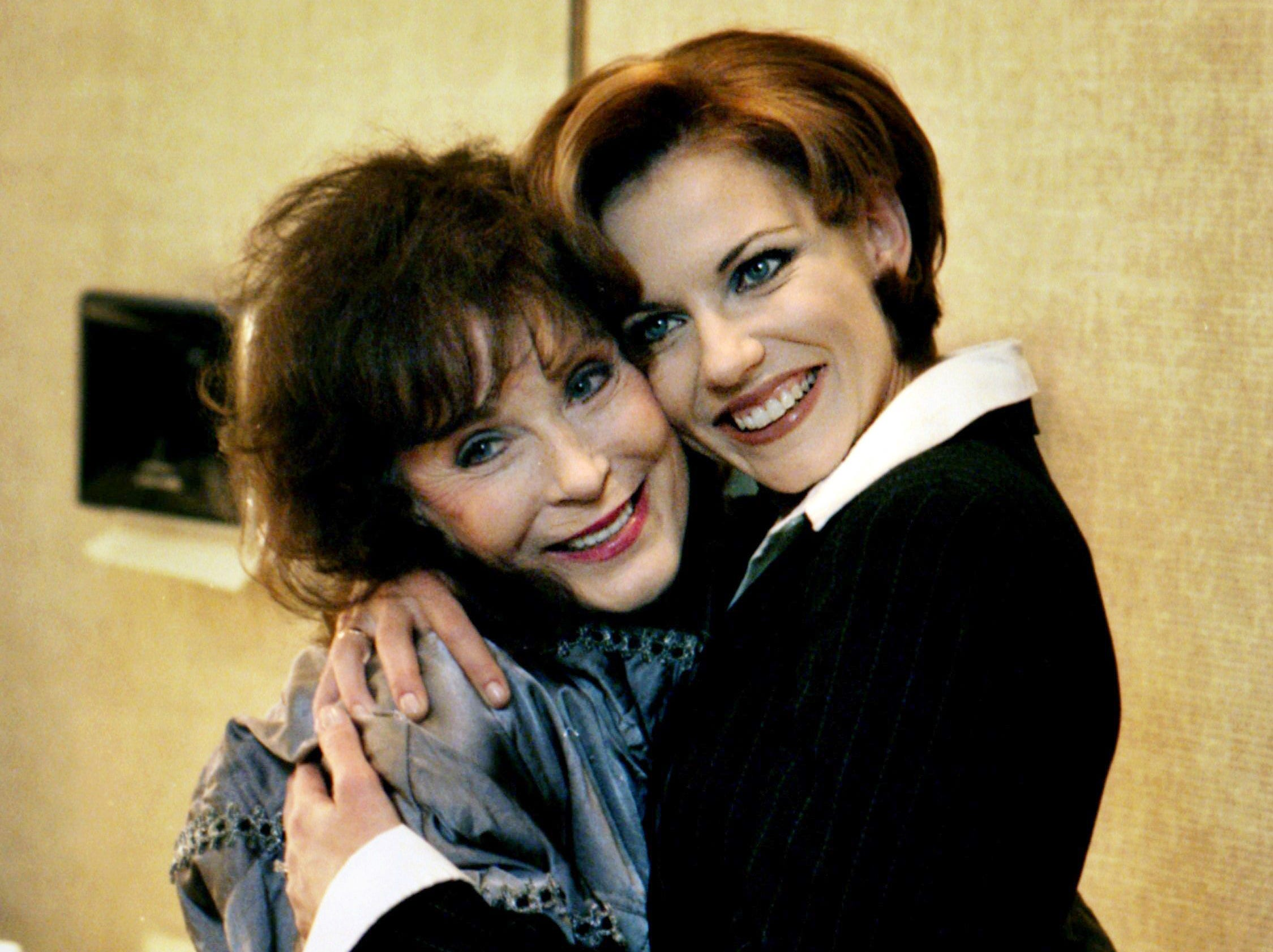 Martina McBride, right, gets a hug from Loretta Lynn backstage at the Opry on the night that McBride was inducted into the Grand Old Opry during its 70th anniversary celebration Nov. 30, 1995.