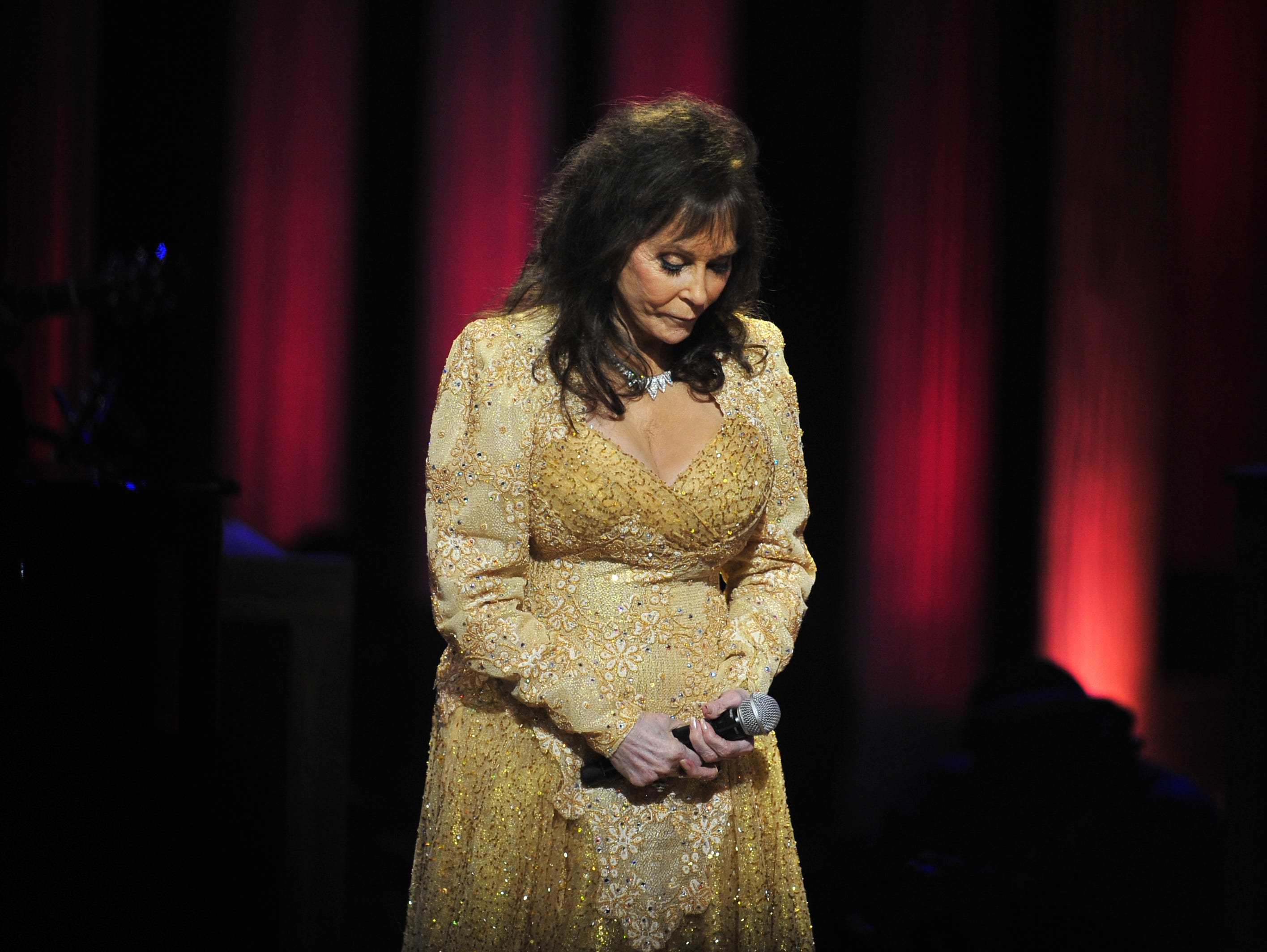 Loretta Lynn takes a bow after performing onstage for the audience at the Grande Ole Opry in Nashville on Sept. 25, 2012. Lynn celebrated her 50th year as an Opry member in 2012.