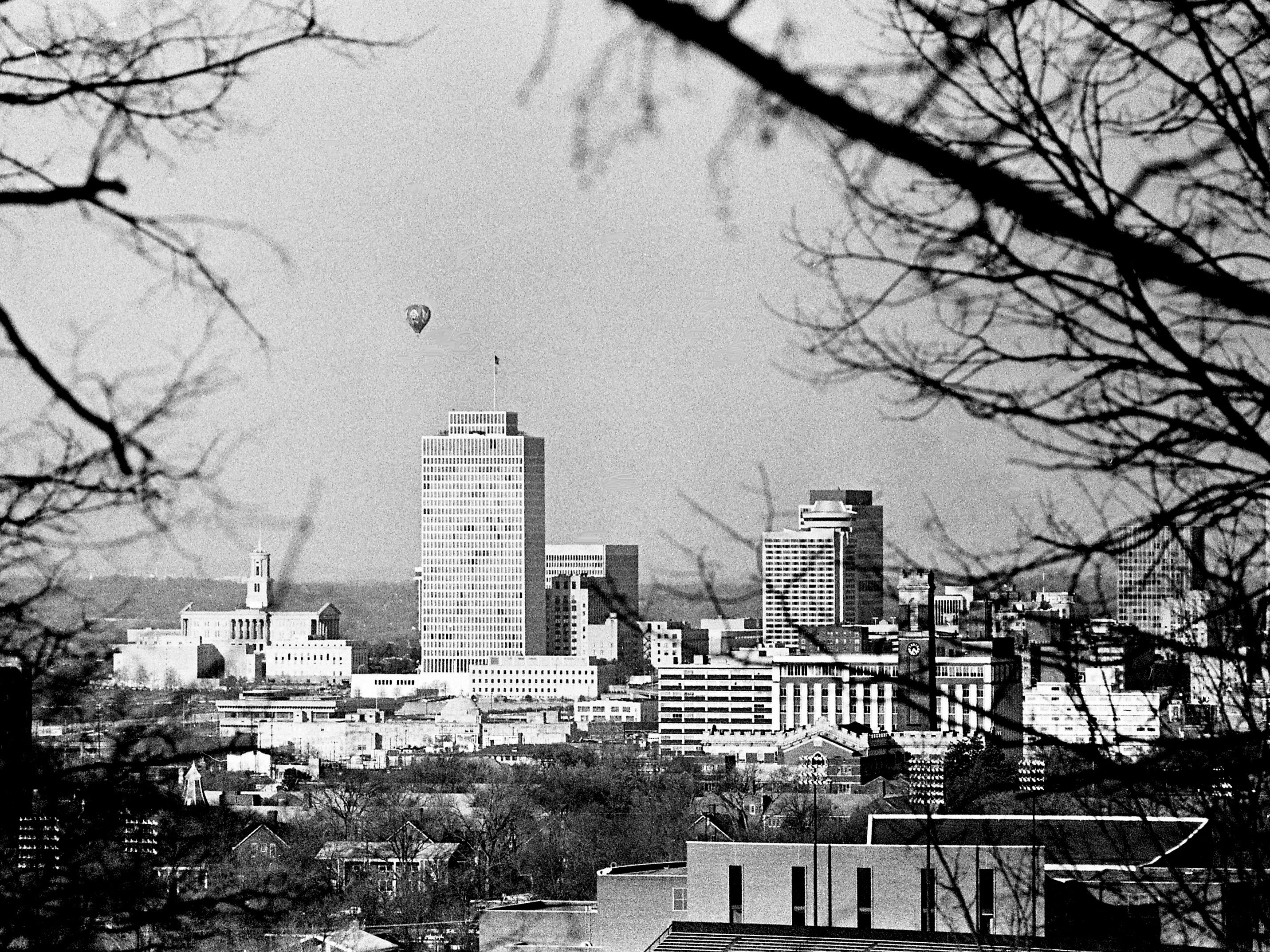 The 100 Oaks Mall balloon is hovering over the Nashville skyline March 10, 1976, advertising the city's semiannual Nashville Extra Value Days. The view is from Love Circle.