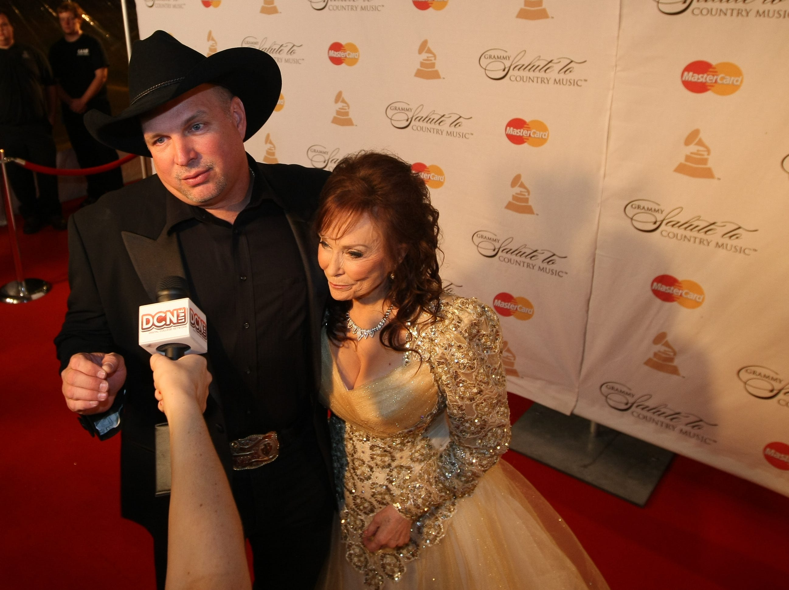 Recording artists Garth Brooks, left, and Loretta Lynn answer questions on the red carpet for the GRAMMY Salute To Country Music¨ honoring Lynn at the Ryman Auditorium Oct. 12, 2010 in Nashville.