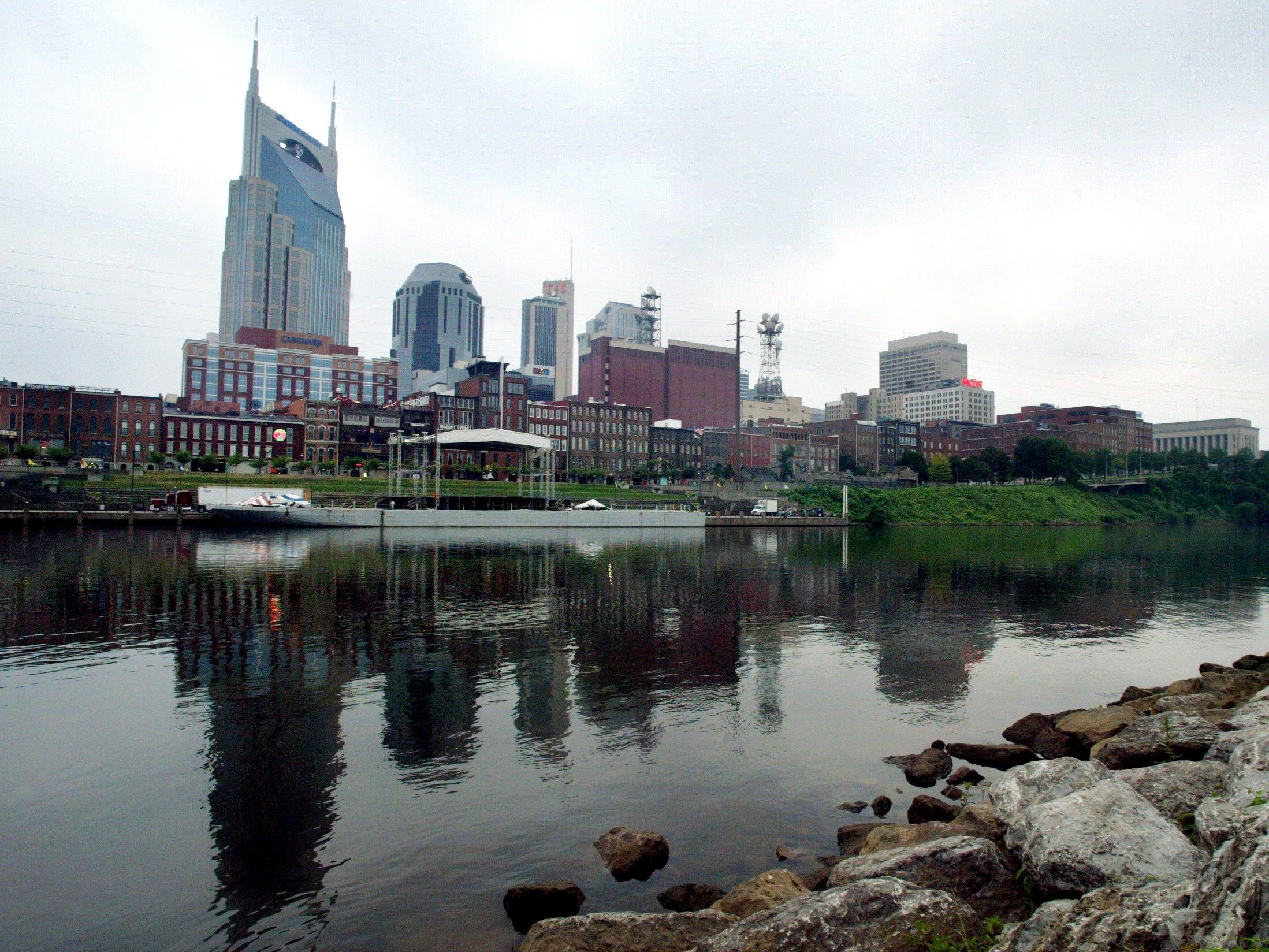 The Nashville skyline reflects along the Cumberland River during a peaceful morning July 17, 2004.
