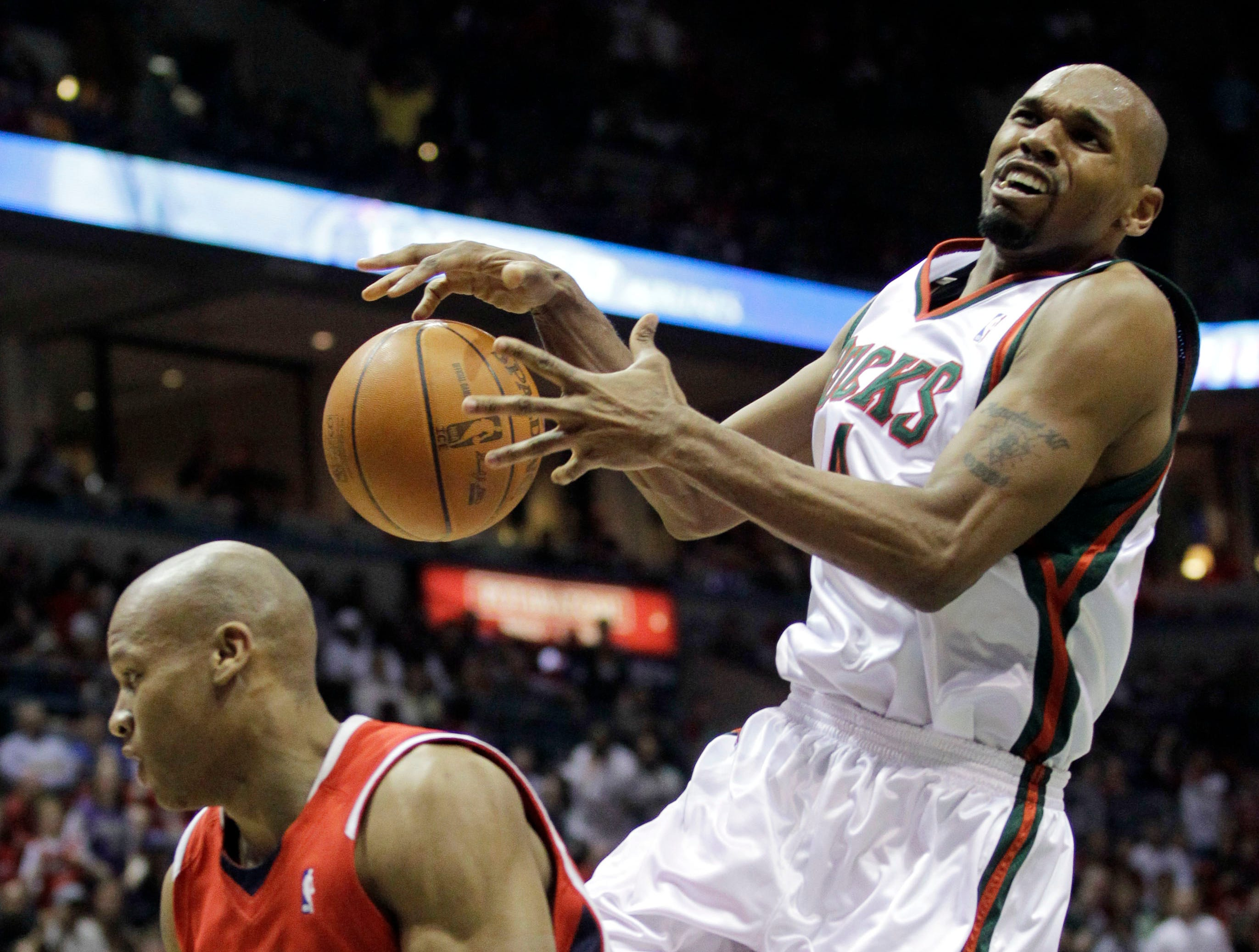 Milwaukee Bucks' Jerry Stackhouse, right, is fouled by Atlanta Hawks' Maurice Evans during the second half of Game  3 of the first round of the NBA basketball playoffs Saturday, April 24, 2010, in Milwaukee.