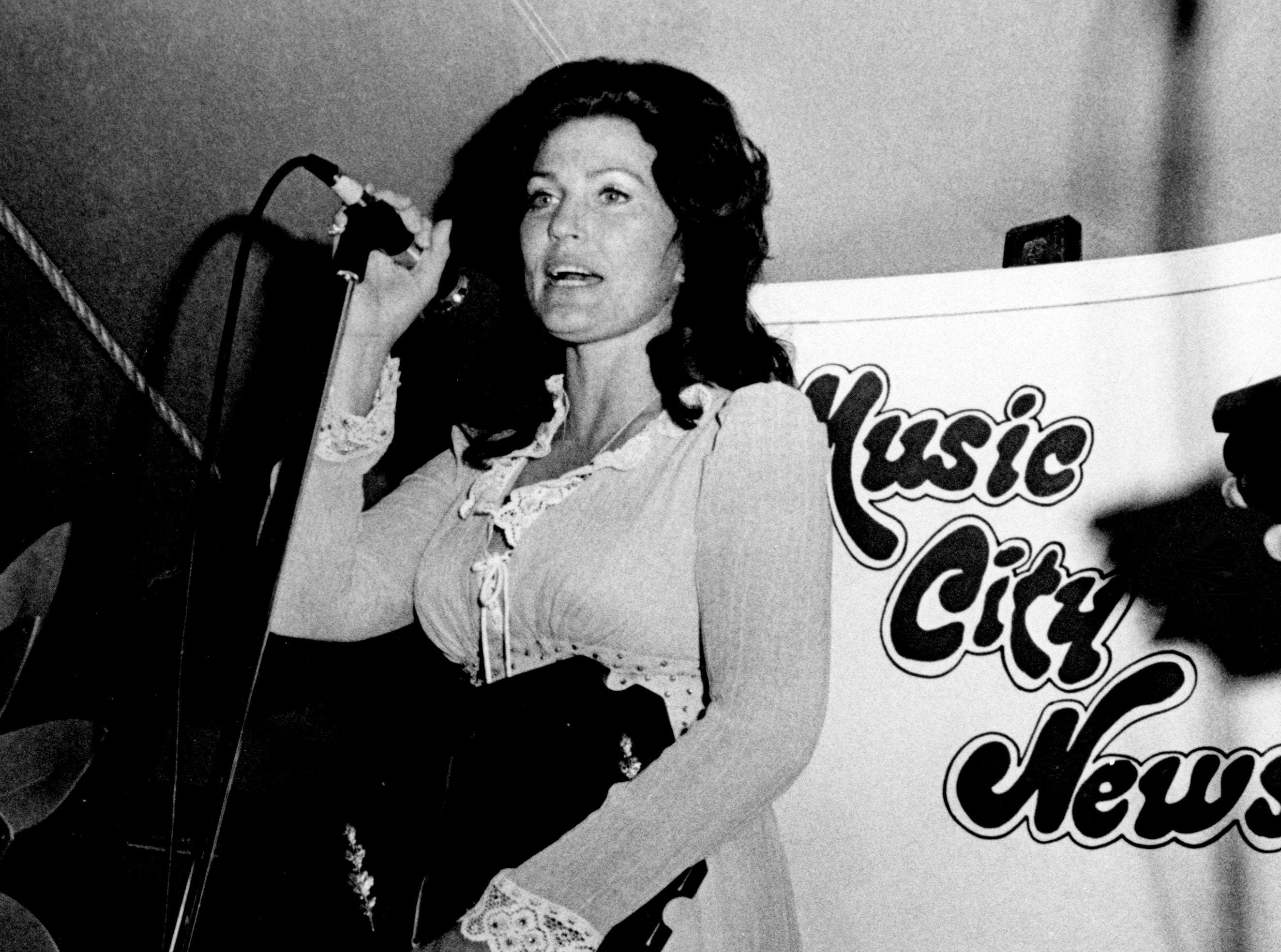 Loretta Lynn accepting her No. 1 Female Artist from the 10th annual Music City News Popularity Poll awards at the IFCO dinner June 9, 1976. Lynn's victory in the female artist category was her 10th in as many years of voting by the readers of Music City News.