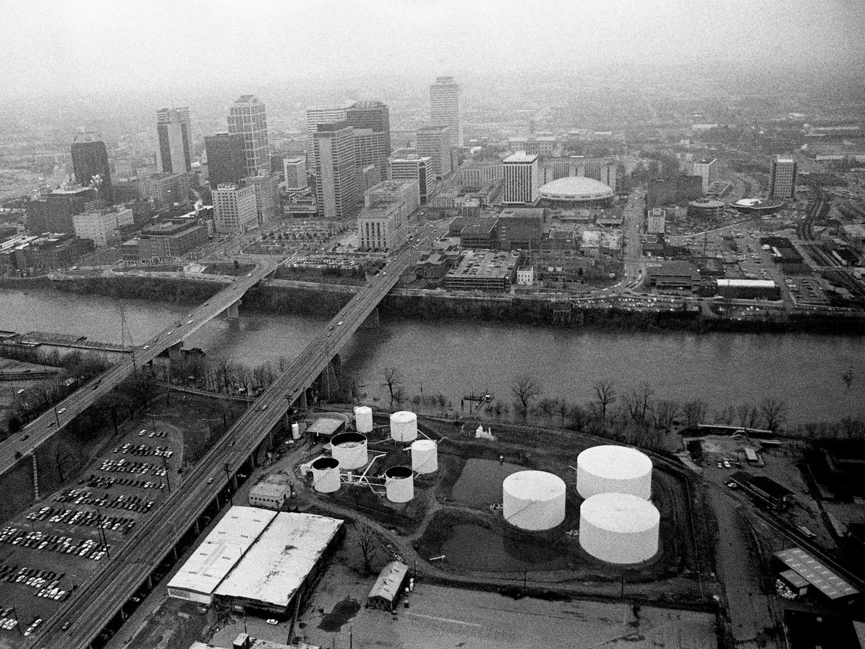 A weekend of almost-constant rainfall which totaled up to 3.32 inches of rain in the area has the Cumberland River very high in downtown Nashville March 6, 1989.