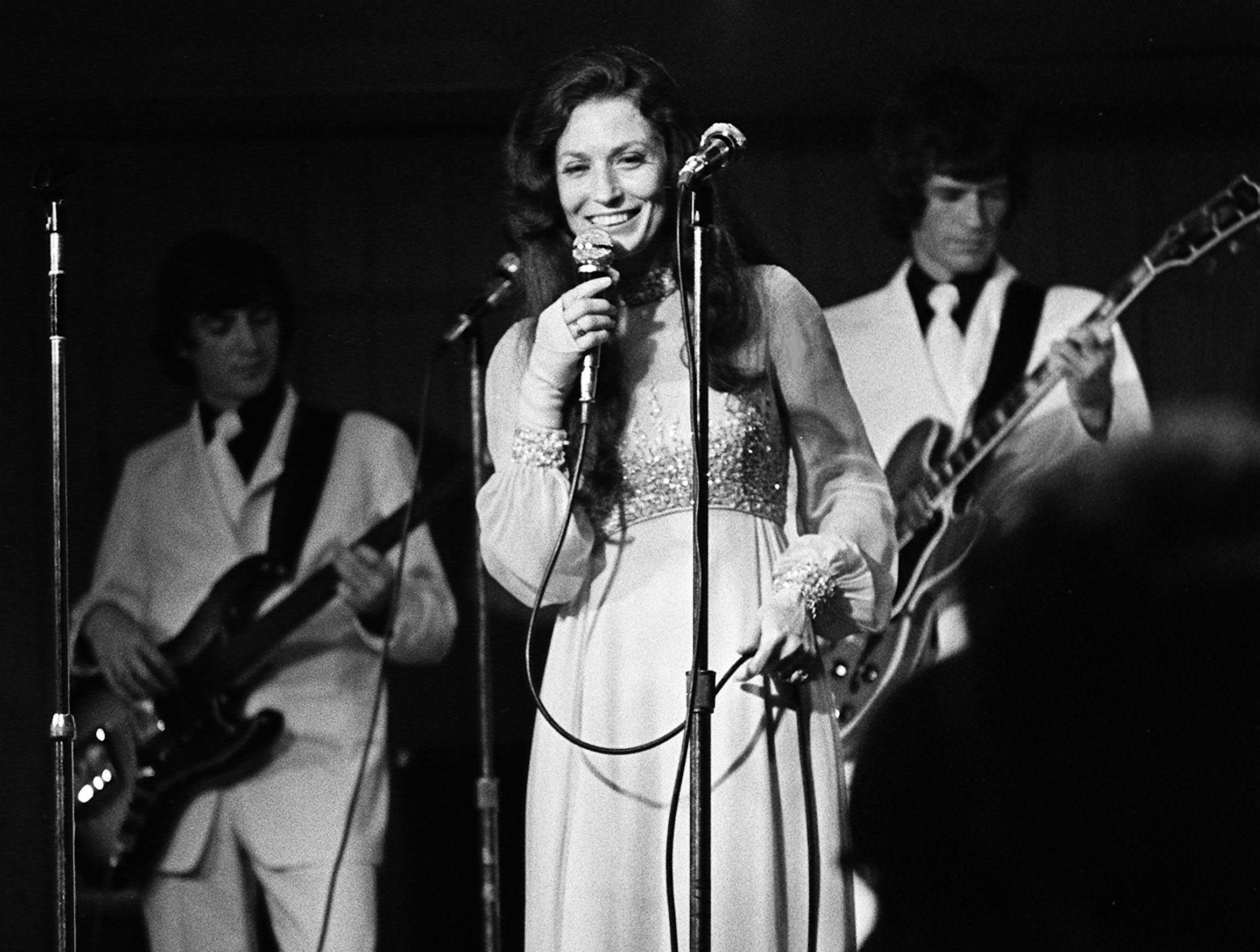 Loretta Lynn performs for 700 fans at a $20-a-plate dinner sponsored by the International Fan Club Organization at the Sheraton Downtown Nashville on June 6, 1973. It was the first night of the second annual Country Music Fan Fair.