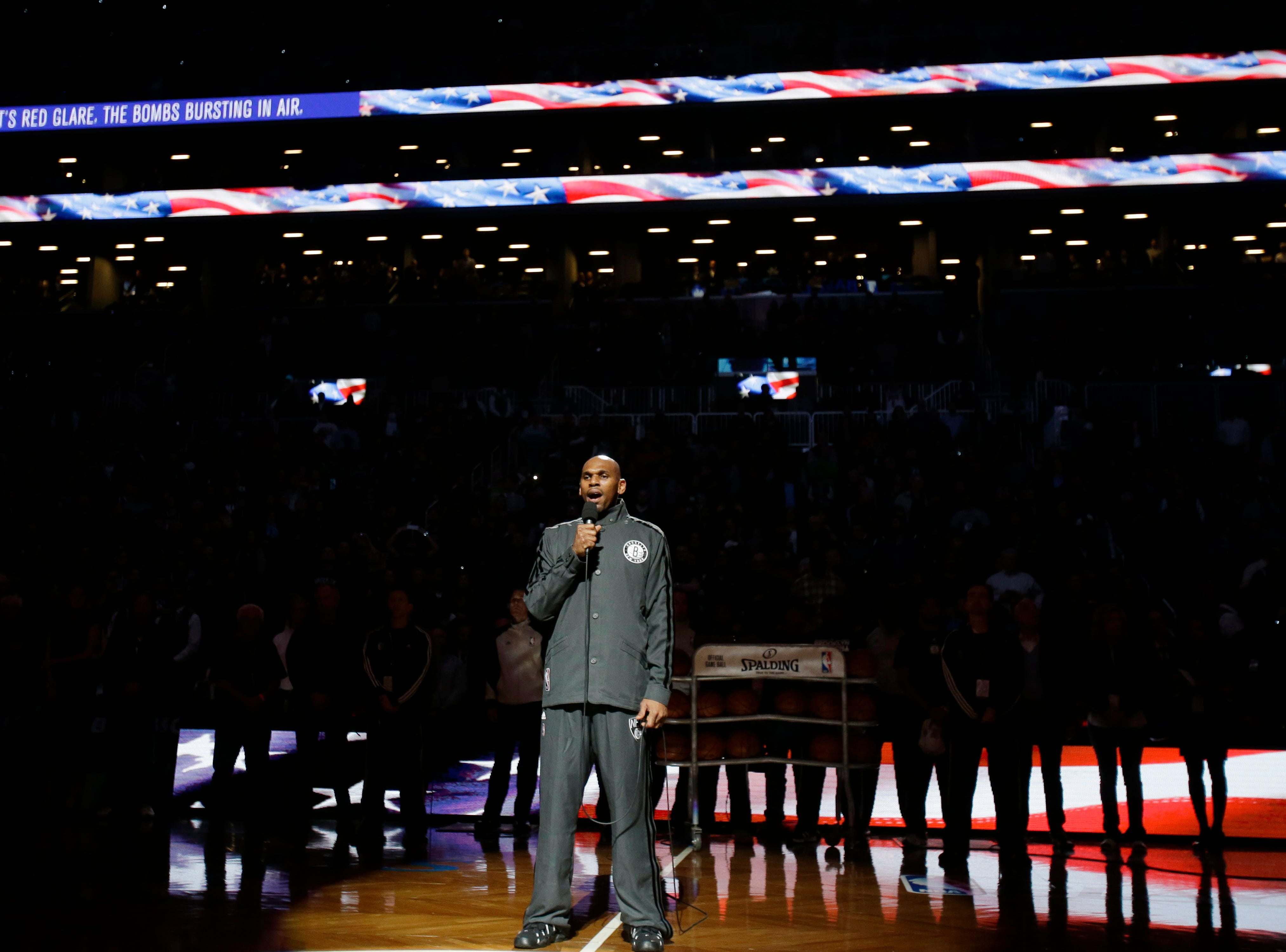 Brooklyn Nets' Jerry Stackhouse sings the national anthem before Game 1 against the Chicago Bulls in the first round of the NBA basketball playoffs at the Barclays Center Saturday, April 20, 2013 in New York.