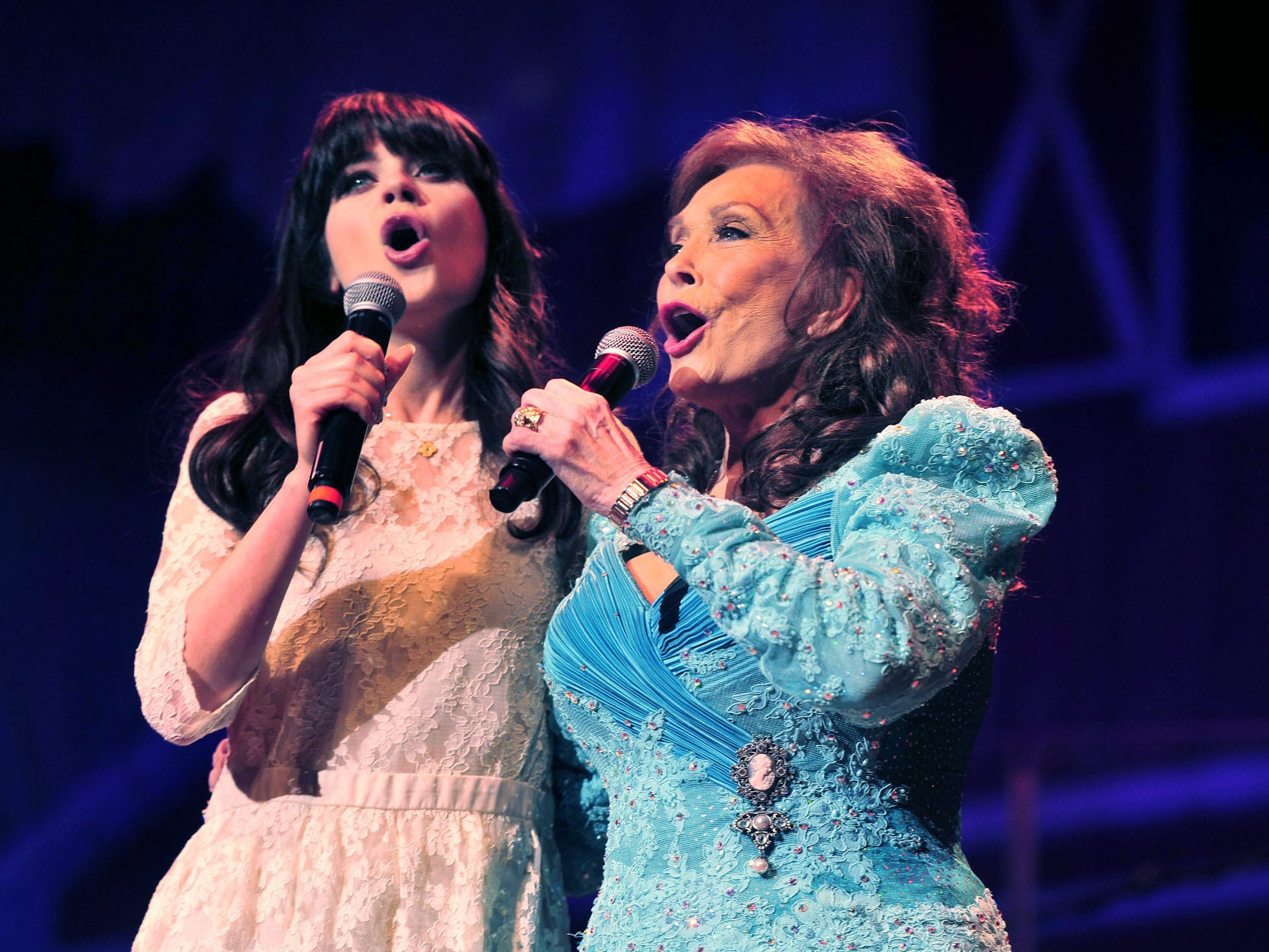 """Zooey Deschanel, left, joins Loretta Lynn onstage to sing """"Coal Miner's Daughter"""" at the Ryman Auditorium on May 10, 2012, in Nashville. Deschanel will play Lynn in a stage version of """"Coal Miner's Daughter."""""""