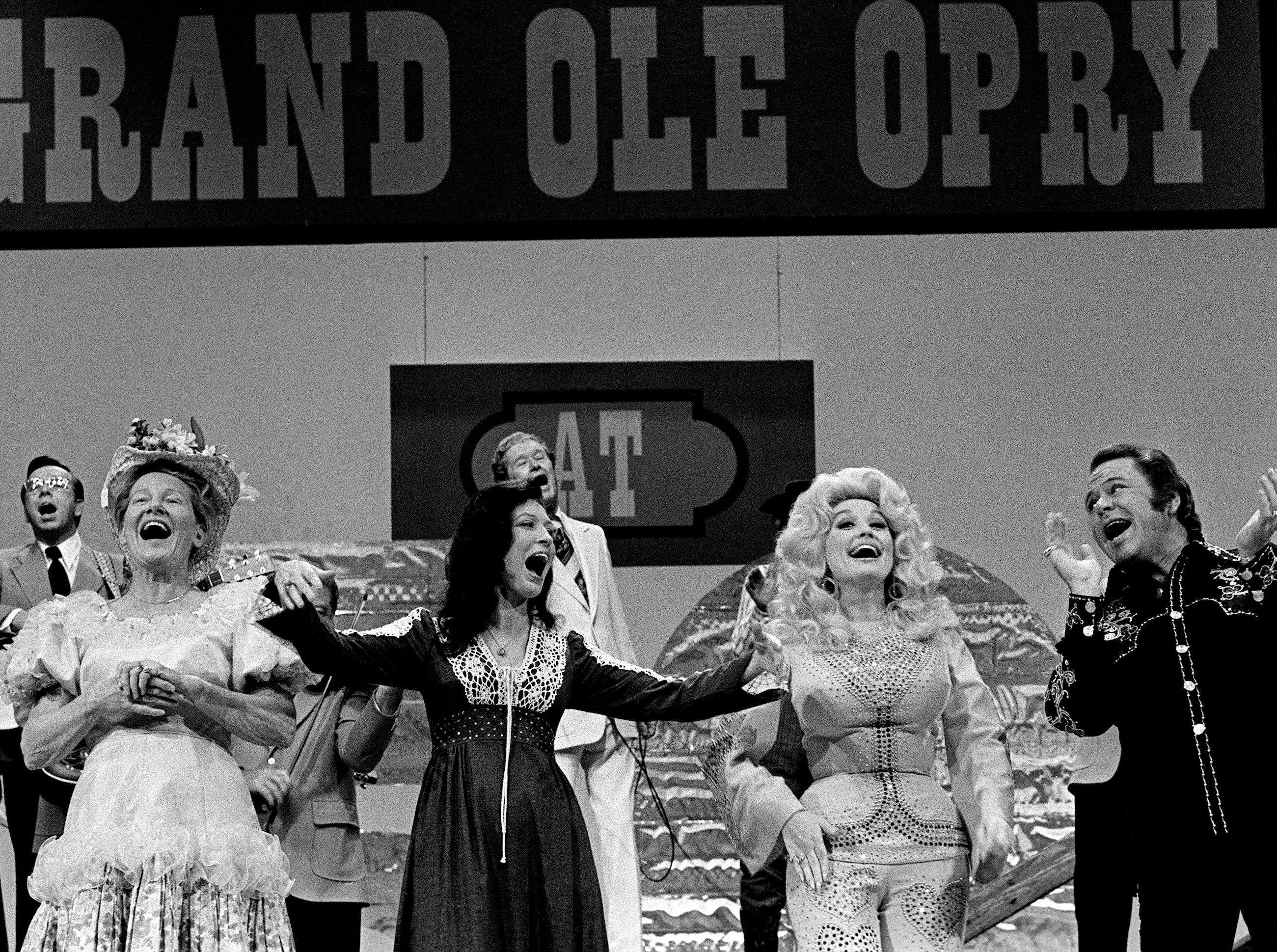 """Minnie Pearl, left, Loretta Lynn, Dolly Parton and Roy Clark are finishes a song together during the end of taping """"The Grand Ole Opry at 50, A Nashville Celebration"""" for a nationally televised special at Opry House Oct. 23, 1975."""