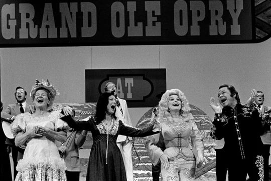 """Minnie Pearl, left, Loretta Lynn, Dolly Parton and Roy Clark are finishes a song together during the end of taping """"The Grand Ole Opry at 50, A Nashville Celebration"""" for a nationally televised special at Opry House Oct. 23, 1975. Ryman Hospitality has a trove of footage from shows performed from the Opry, which could be included in its new television project."""