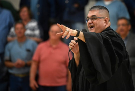 Dr. Eduardo Rocha gestures, points, shouts and jumps during a revival meeting for the inmates at Riverbend on March 31.