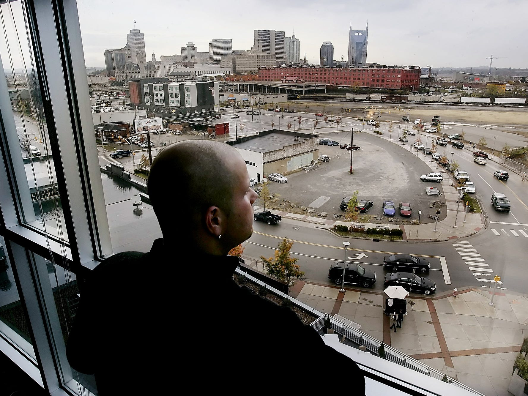 Elliott Holt looks out at his fabulous view from his home at the Mercury View Lofts in the Gulch Nov. 1, 2006.
