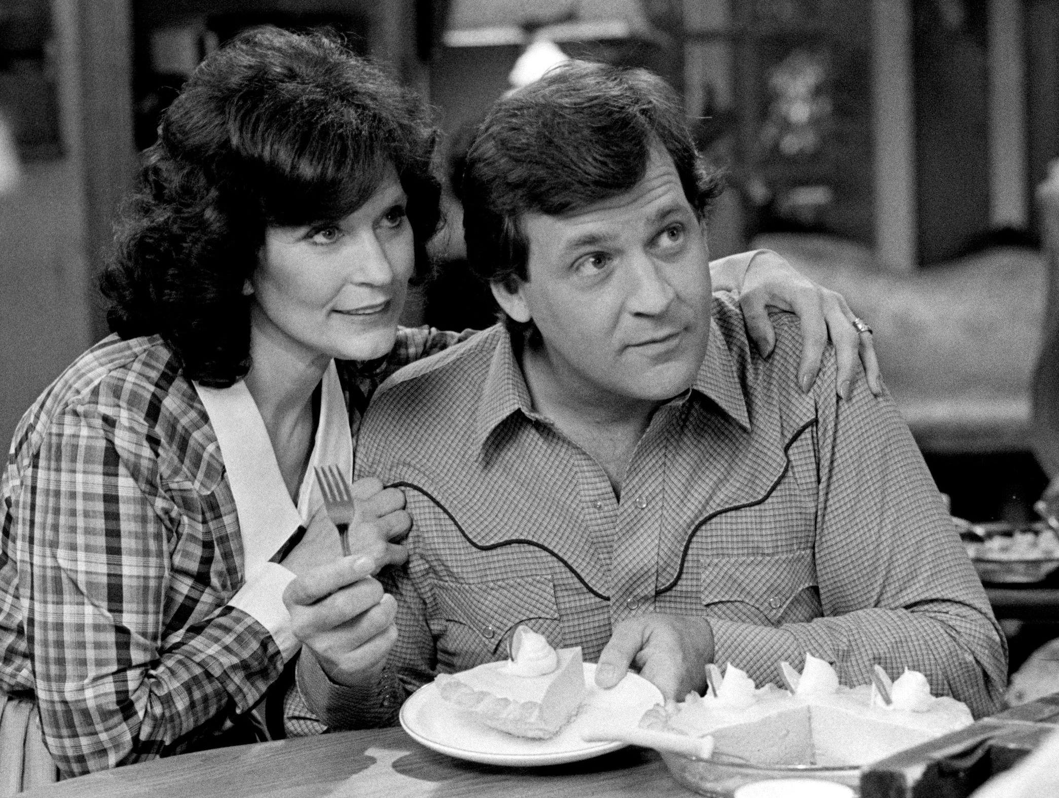 Loretta Lynn, left, is working with songwriter Steve Pippin during the taping of her new Crisco commercial at the Tennessee Performing Arts Center in Nashville March 25, 1983. Lynn, a gal that knows how to make her own pies and cakes, use Crisco at home.