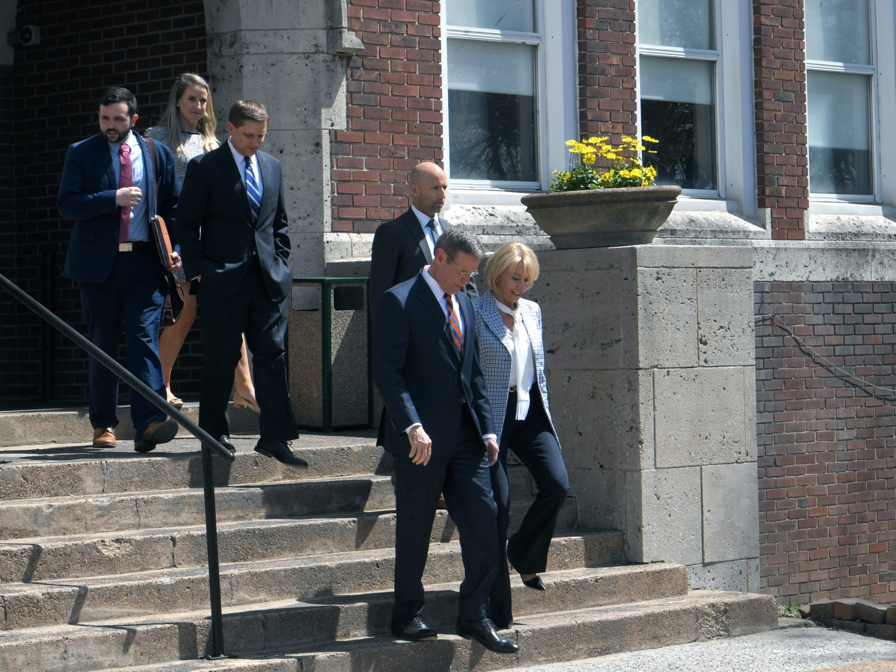 Gov. Bill Lee and Education Secretary Betsy DeVos leave LEAD Cameron Middle School after touring the Nashville school on Monday, April 1, 2019.