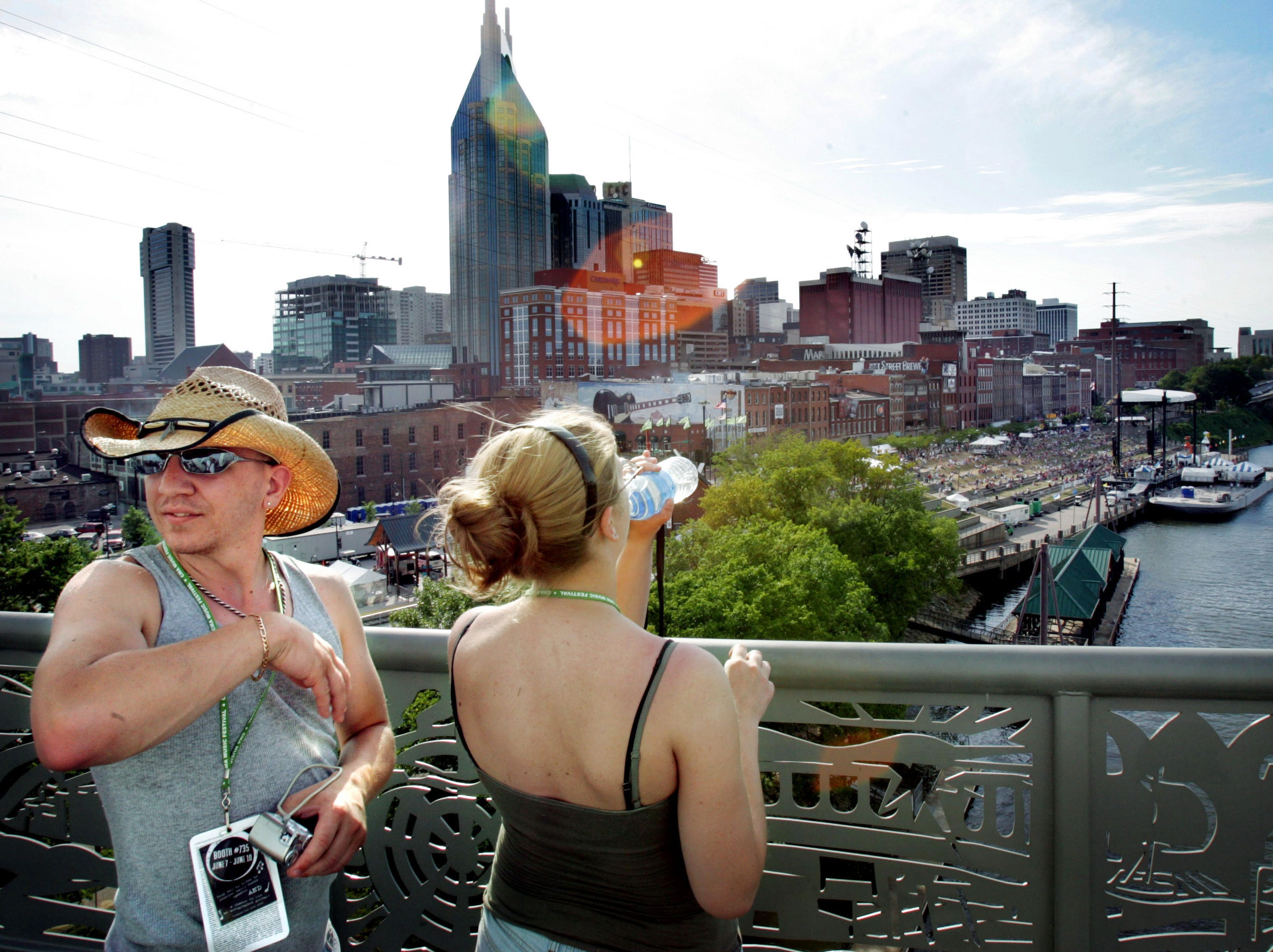 Josh Brace and Sarah Venditti take in the view of the Nashville skyline from the Shelby Street pedestrian bridge June 10, 2007 during the CMA Music Festival. The couple drove 22 hours from Vermont to be a part of this years activities.