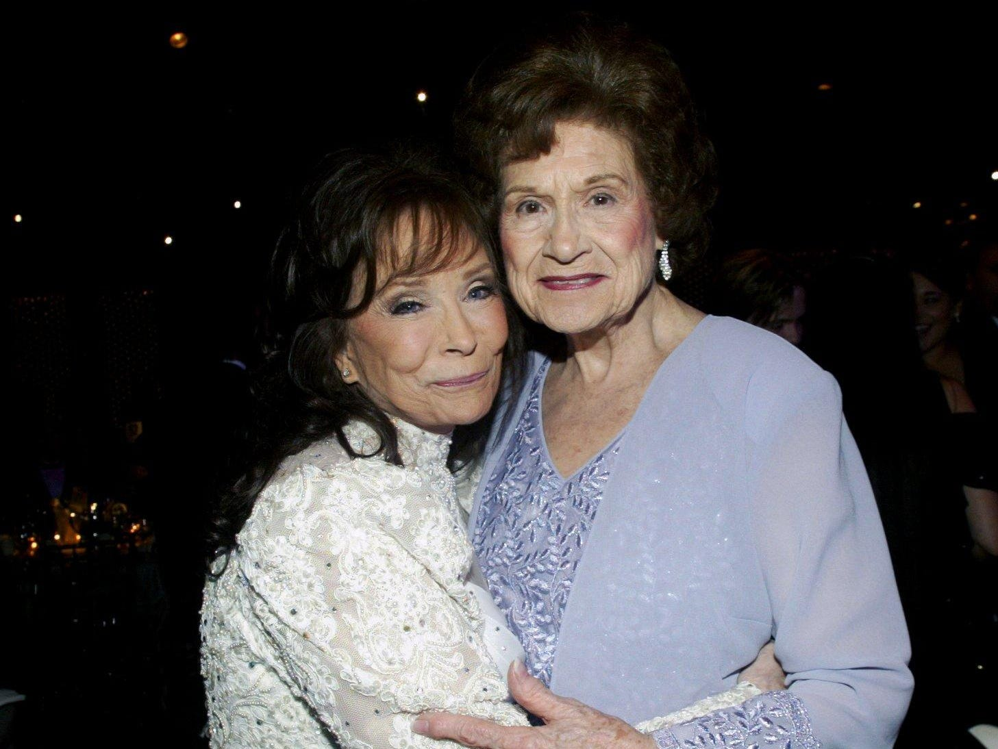 Loretta Lynn, left, hugs fellow Country Music Hall of Famer and friend Kitty Wells at the 2004 BMI Country Awards dinner and show Nov. 8, 2004. Lynn was given a BMI ICON award during a tribute to her.