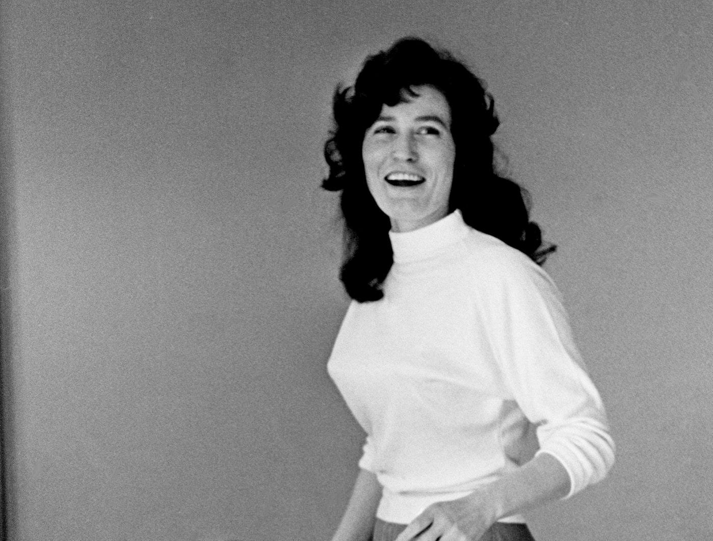 Loretta Lynn shows how she had to practice walking in high heel shoes Jan. 31, 1962, before she could run onto the Grand Ole Opry stage without stumbling. The singer prefers boots, but the Wilburn Brothers insisted she wear high heels.