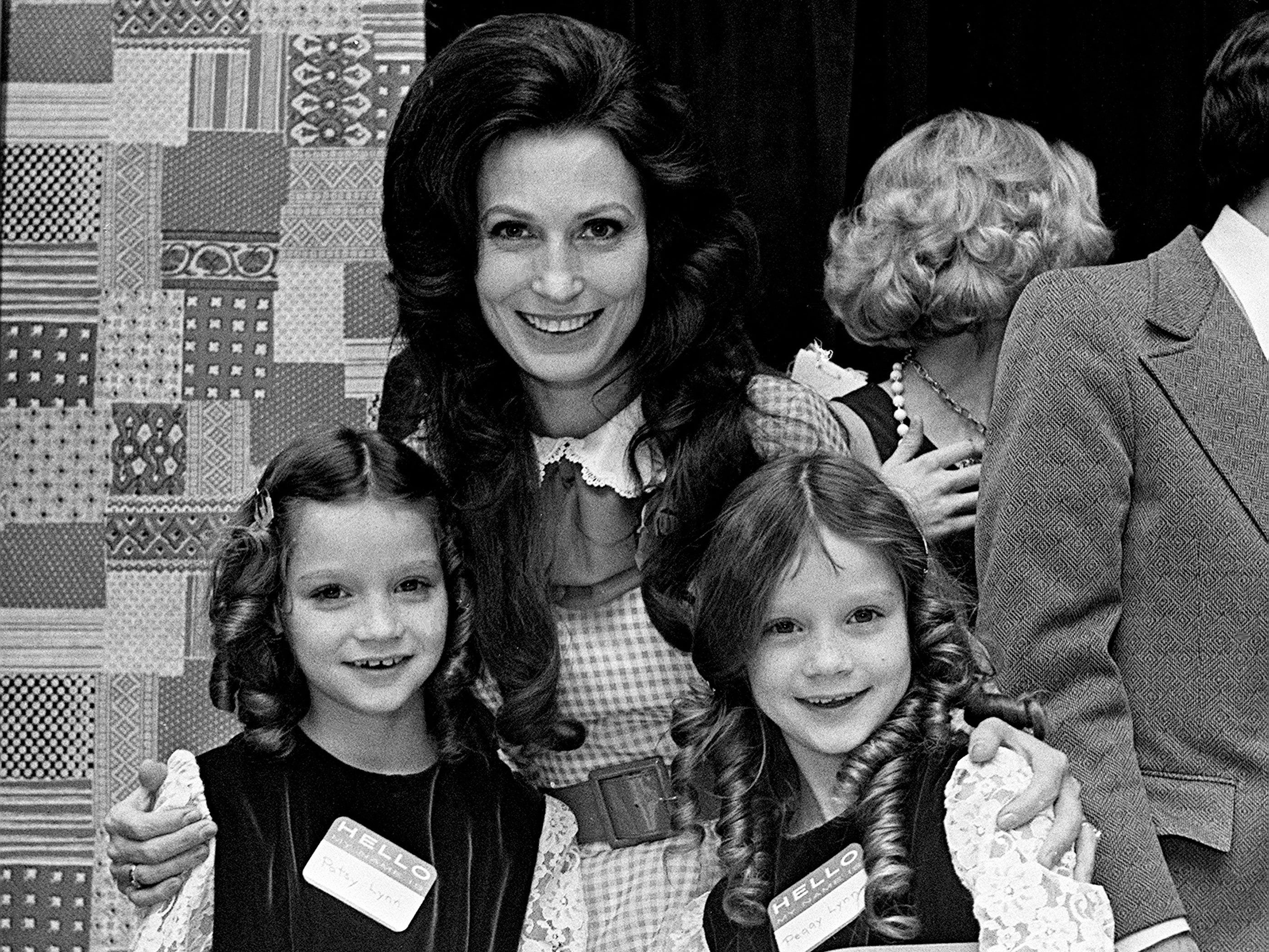 Loretta Lynn, center, one of the Women of the Year for 1972, is with her twins daughters, Patsy, left, and Peggy, at the banquet honoring the Women of the Year at the Woodmont Country Club on Feb. 13, 1973.