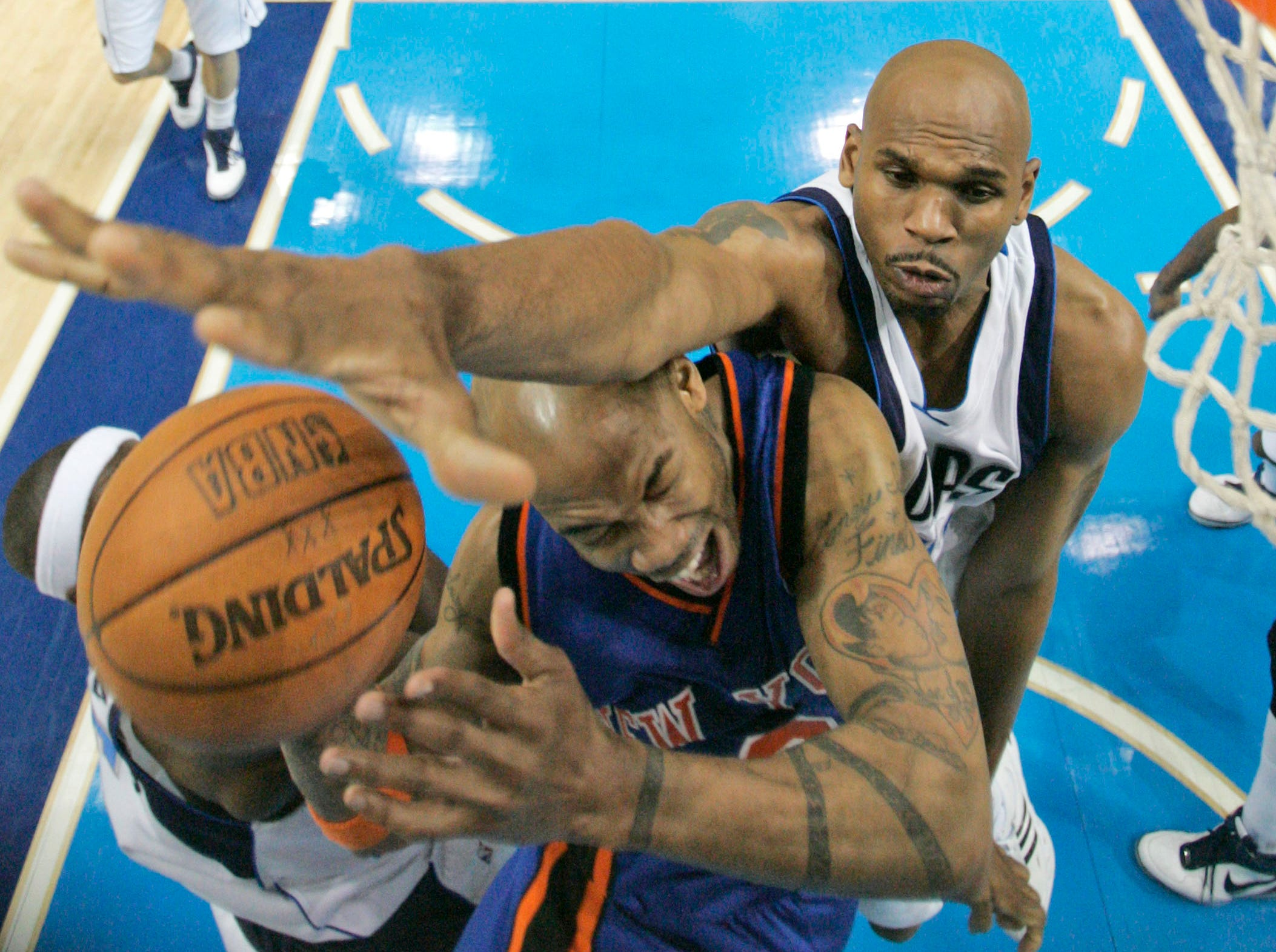 Dallas Mavericks guard Jerry Stackhouse, top, fouls New York Knicks guard Stephon Marbury (3) as Marbury tries to score in the second half of an NBA basketball game in this March 30, 2007, file photo in Dallas. Dallas won 105-103.