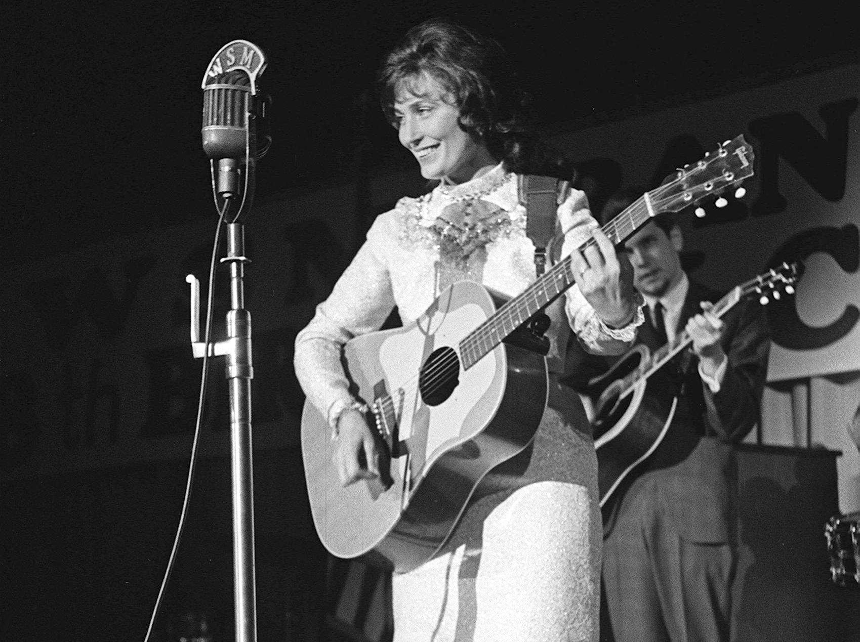 Loretta Lynn steps up to the mic at one of the shows during the 12th annual Country Music Festival at Municipal Auditorium, Nov. 1, 1963.