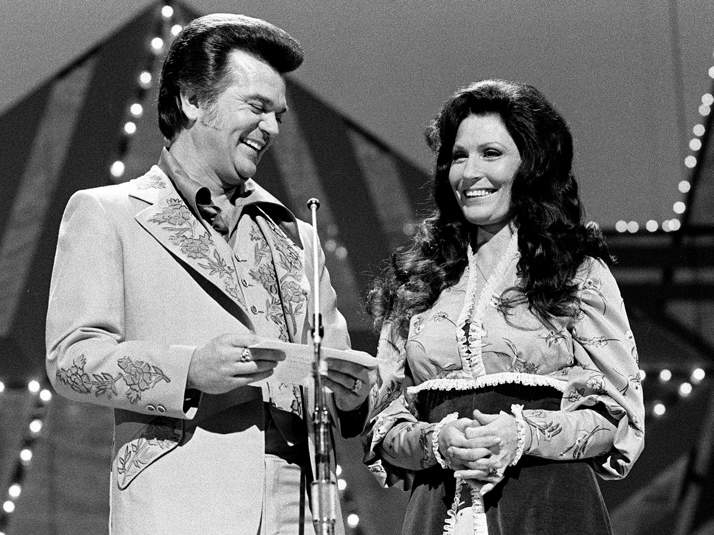 Loretta Lynn, right, and Conway Twitty are presenting the Vocal Duo of the Year award during the nationally televised CMA awards show from the Grand Ole Opry House Oct. 11, 1976.