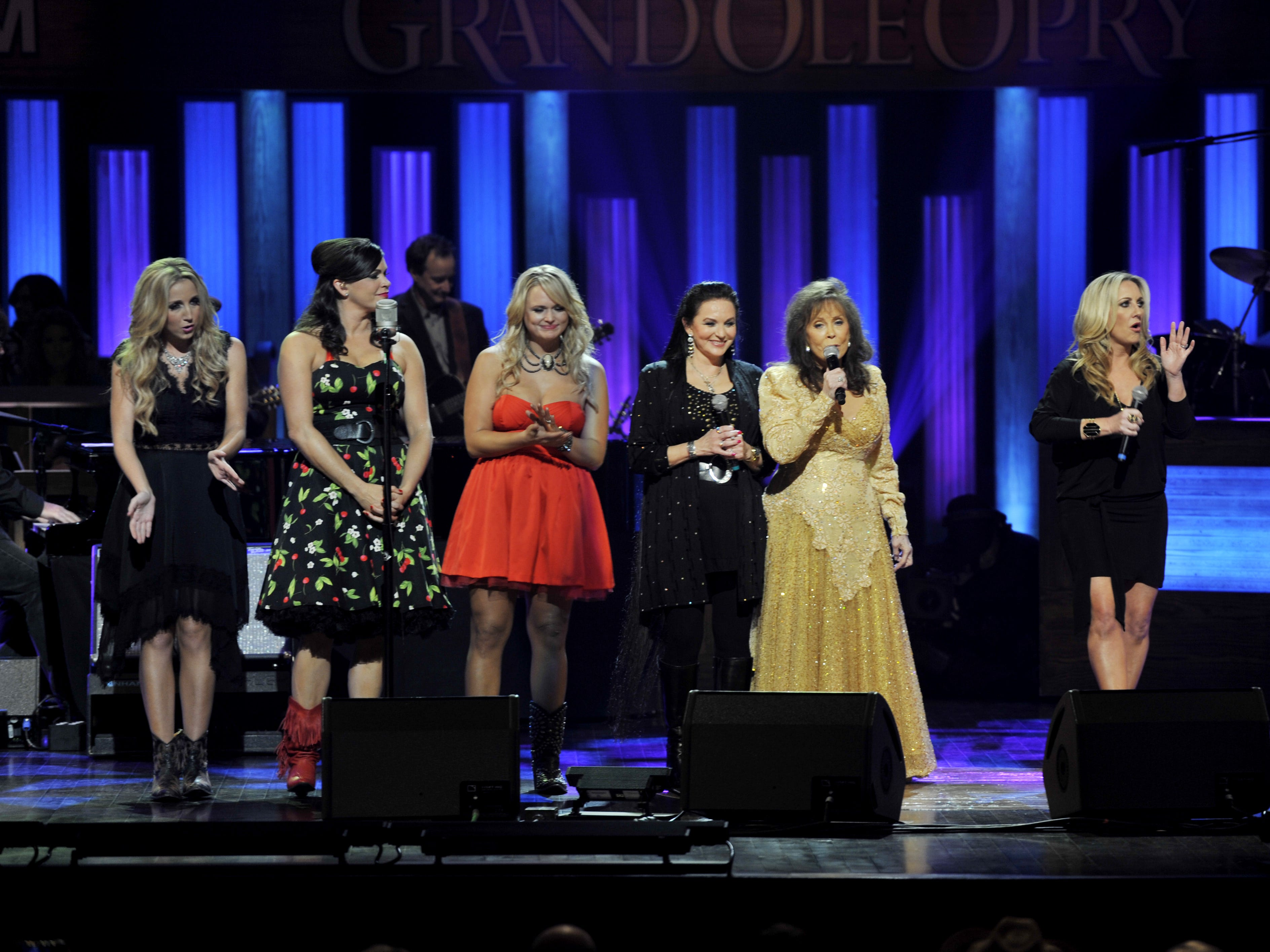 Loretta Lynn, second from right, is joined by Ashley Monroe, left, Angaleena Presley and Miranda Lambert of the Pistol Annies; her sister, Crystal Gayle; and Lee Ann Womack as Lynn performs onstage at Grande Ole Opry to celebrates her 50th anniversary as an Opry member on Sept. 25, 2012.