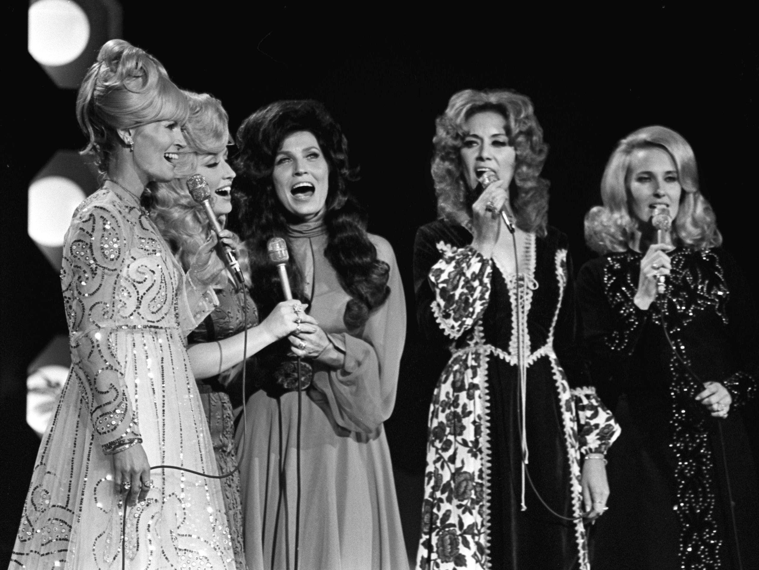 Performing a country girl theme are Lynn Anderson, left, Dolly Parton, Loretta Lynn, Dottie West and Tammy Wynette during the annual CMA Awards show at the Grand Ole Opry House on Oct. 16, 1972.