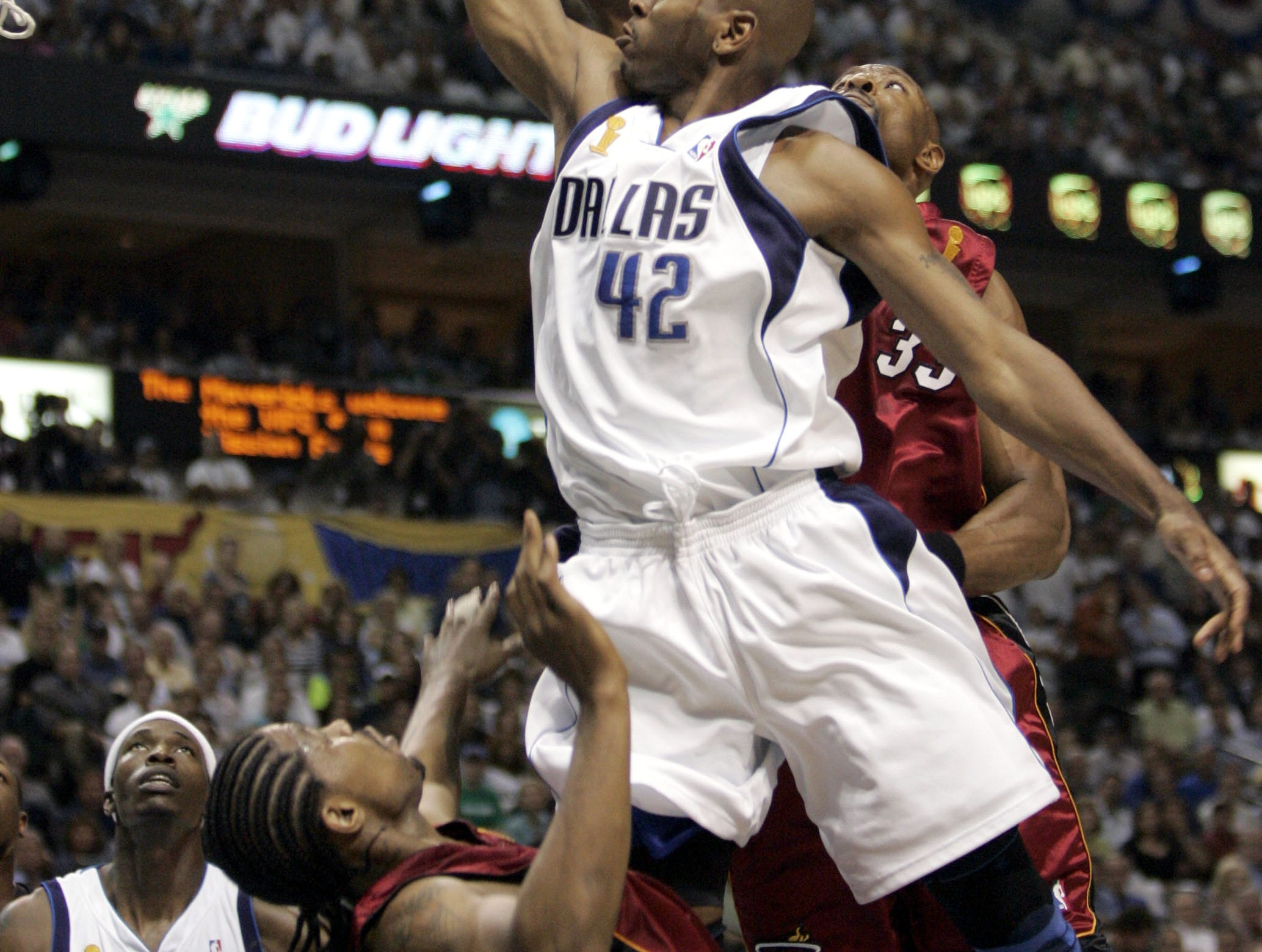 Dallas Mavericks' Jerry Stackhouse (42) takes a gliding lay up as Miami Heat's Alonzo Mourning (33) and Udonis Haslem (40) defend in the second quarter in Game 6 of the NBA basketball finals in Dallas, Tuesday, June 20, 2006.