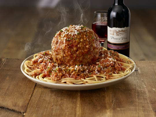 "New ""Giant Italian Classics"" at Olive Garden include a house-made giant meatball topped with homemade meat sauce and served with spaghetti."