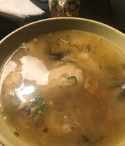Take-out Bubbie's chicken soup with matzo balls from JewBan's Deli Dàle food truck based in Southwest Florida.