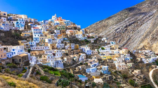 Naples resident and active volunteer Tina Delamaras was born in a small mountain village, like this one on the island of Karpathos in Greece. Because of the remoteness of the island, she says, it has preserved many of its customs and family values.