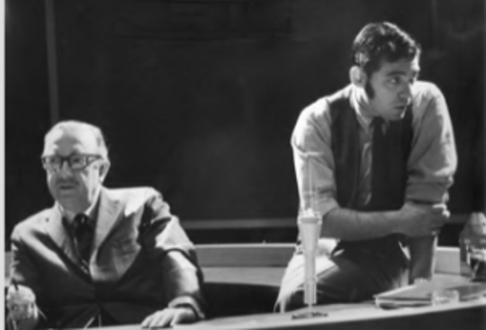 Joel Banow, right, on the CBS News set with news anchor Walter Cronkite, left, during the Apollo 11 moon landing mission in 1969.