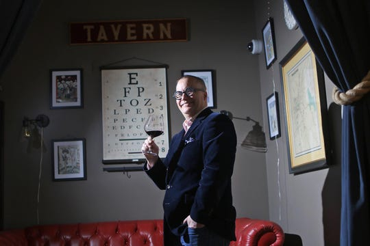 Owner of Jockey Hollow Bar & Kitchen, Christopher Canon poses with a glass of wine, in Morristown. Wednesday, March 27, 2019