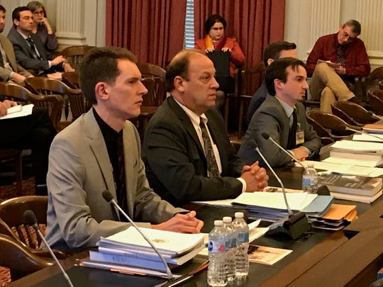 Representatives of the Office of Legislative Services, from left, Thomas Koenig, Frank Haines and David Drescher, testify in front of the Assembly Budget Committee in the Statehouse on April 1, 2019.