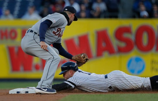 New York Yankees' Brett Gardner steals second base safely ahead of the tag from Detroit Tigers shortstop Jordy Mercer during the first inning of a baseball game, Monday, April 1, 2019, in New York. (AP Photo/Julie Jacobson)
