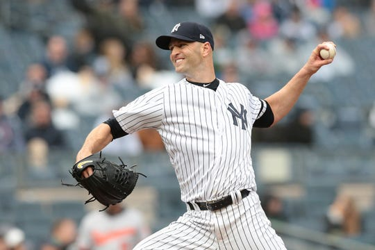 New York Yankees starting pitcher J.A. Happ delivers a pitch during the first inning against the Baltimore Orioles at Yankee Stadium.