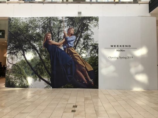"Weekend Max Mara will open at Westfield Garden State Plaza in Paramus by mid-April. On Mon., April 1, 2019, the store is boarded up with a sign that reads ""Opening Spring 2019."""