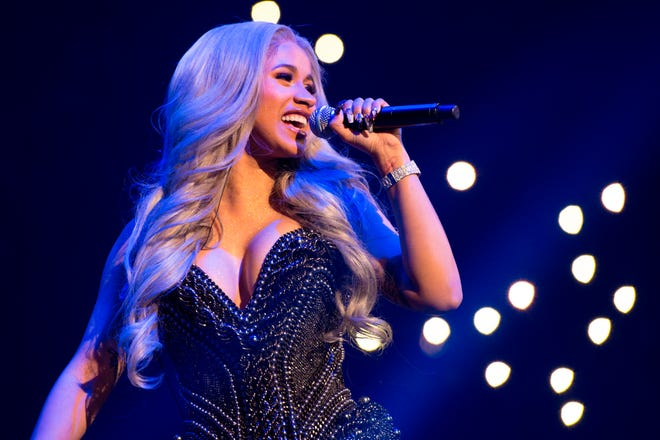 In this Oct. 26, 2017 file photo, recording artist Cardi B performs in New York. Cardi B will perform at the annual Summer Jam concert, one of the year's top hip-hop shows, on June 2 at MetLife Stadium in East Rutherford, as well as Labor Day weekend on the Ben Franklin Parkway in Philadelphia, as part of Jay- Z's Made in America festival.