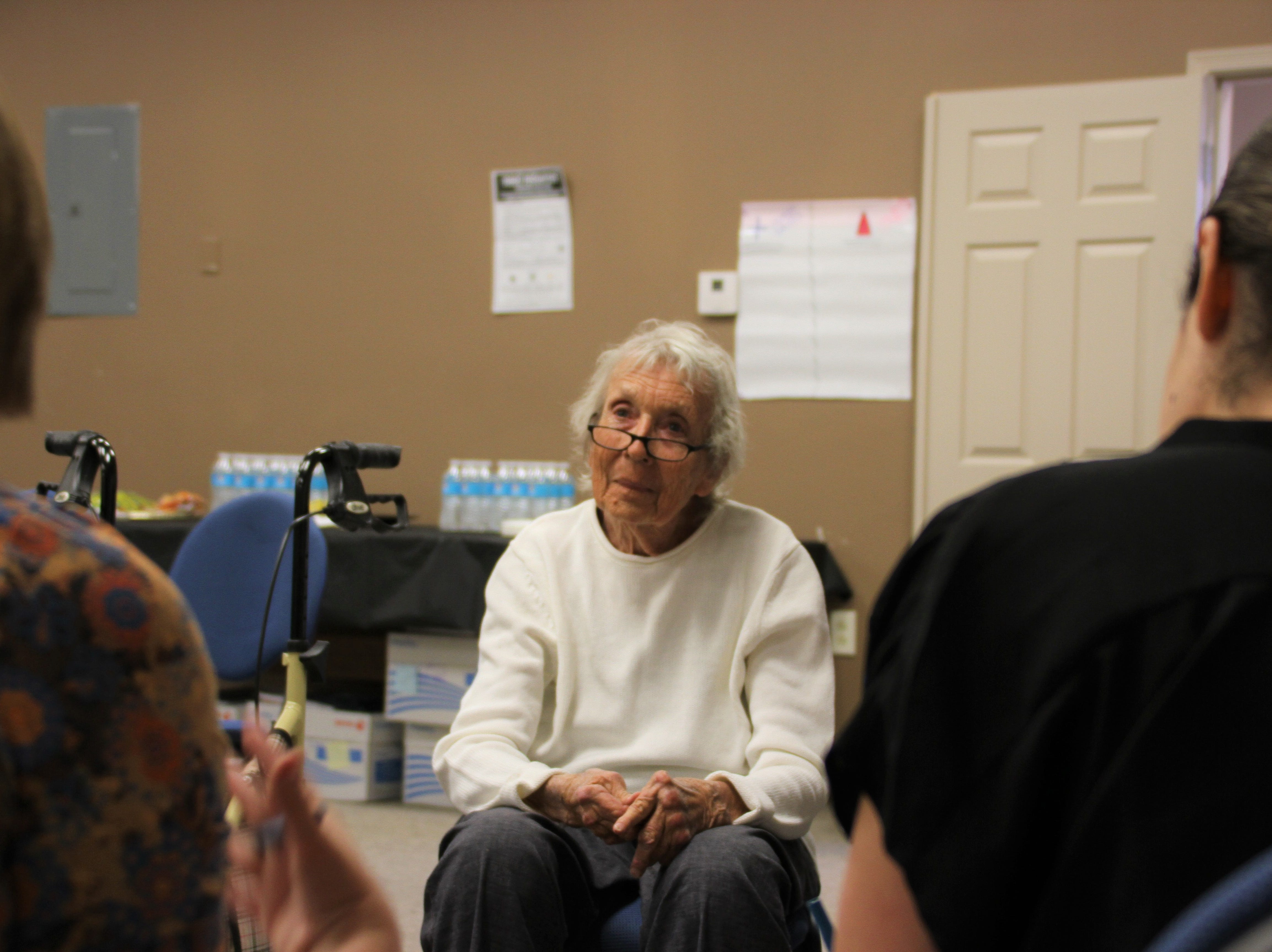 Barbara Agte of Columbus, New Mexico sits in with the community members group.
