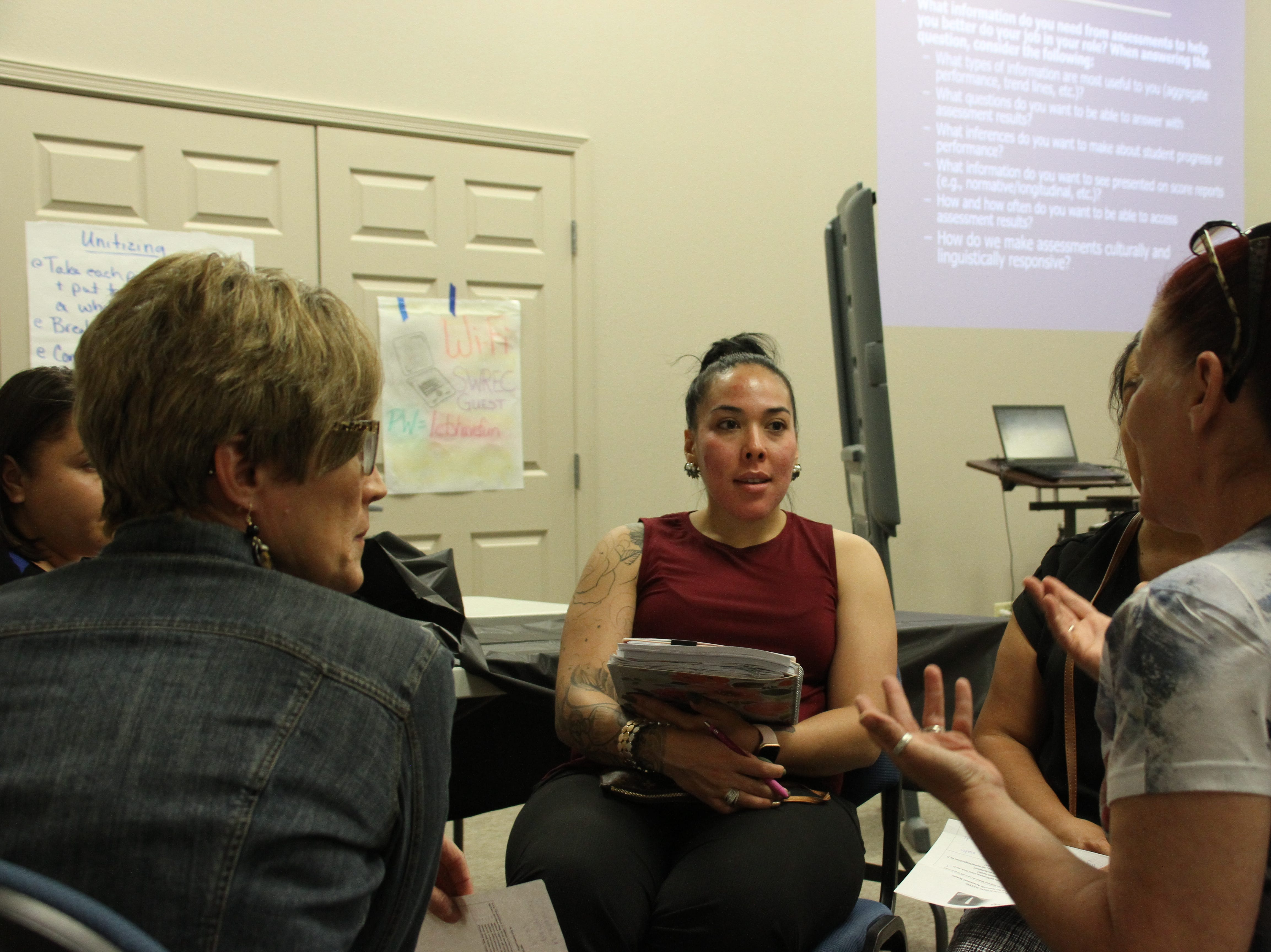 At center, participant Jessica Jara listens in on conversations discussed within  the parent group.