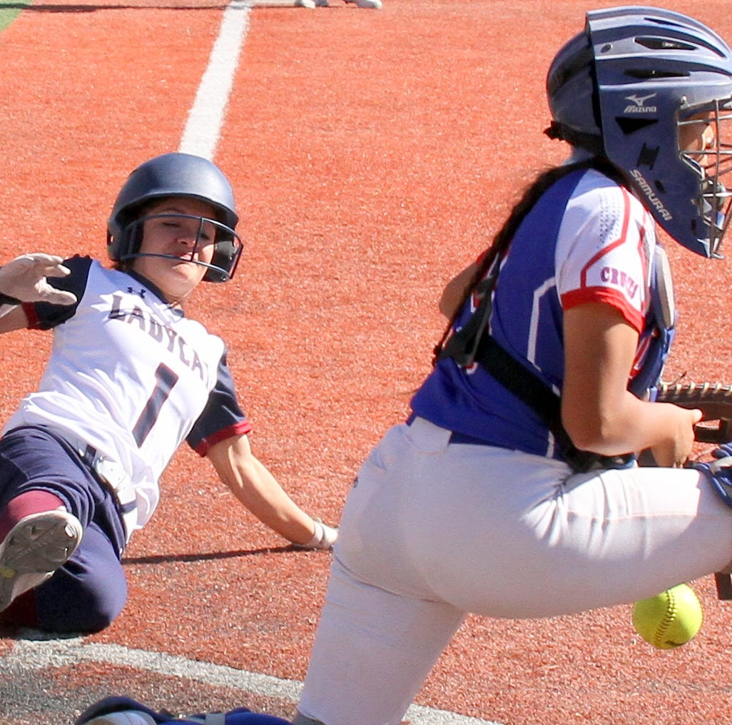 Deming High Lady 'Cats split District 3-5A home double-header with Las Cruces High