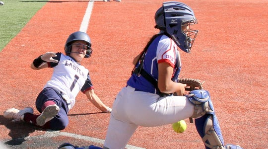 Freshman Lady 'Cat Bianca Valverde slid home safely to score Deming's first run of the game during Friday's District 3-5A double-header against the Las Cruces High Bulldawgs at E.J. Hooten Park. The 'Cats beat the 'Dawgs, 4-2 in the opener and lost 11-1 in the nightcap.