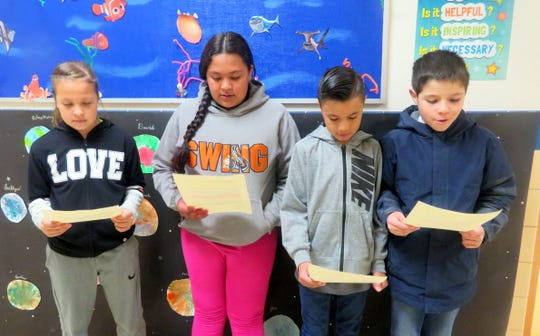 Pictured, from left, are Leah Gonzales, Lupe Duran, Isaac Galaz, and Joas Trotter are practicing for a radio spot which will air on Deming Radio.