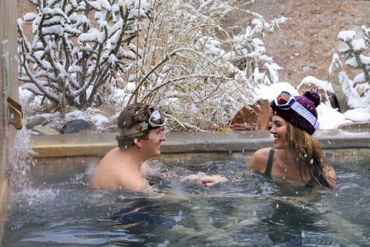 A couple relaxes at the Ojo Caliente Mineral Springs and Resort in this publicity photo.
