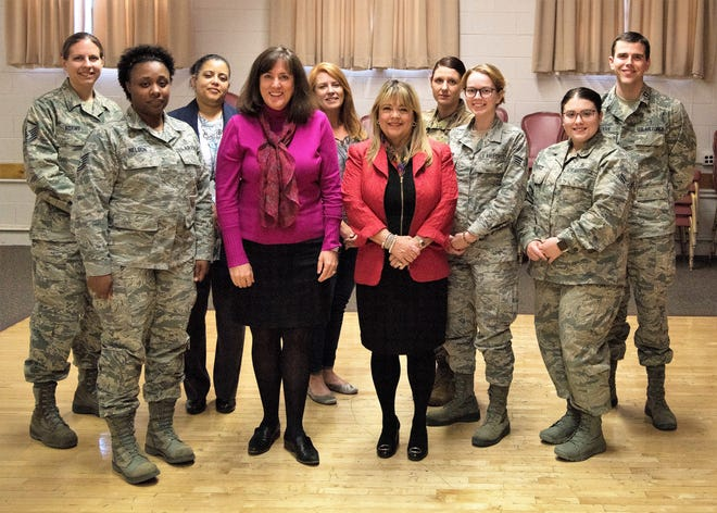 Airmen pose with (center right) Dr. Tina Byford, interim vice president of university advancement of New Mexico State University, and (center left) Leslie Cervantes, associate VP of alumni and donor relations of NMSU, after an open forum at the Community Activities Center on Holloman Air Force Base, N.M., March 19, 2019. Byford and Cervantes spoke to Airmen about their experiences as female leaders and how they achieved success in honor of Women's History Month.