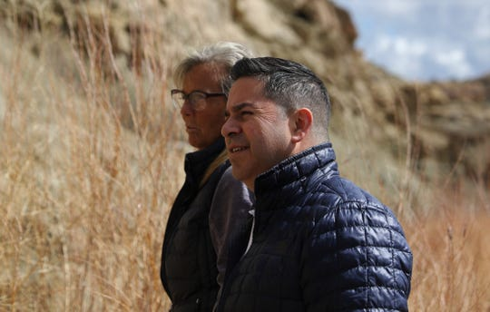 Ben Ray Lujan and Danene Sherwood discuss the Farmers Mutual Ditch, Thursday, March 21, 2019, in Farmington.